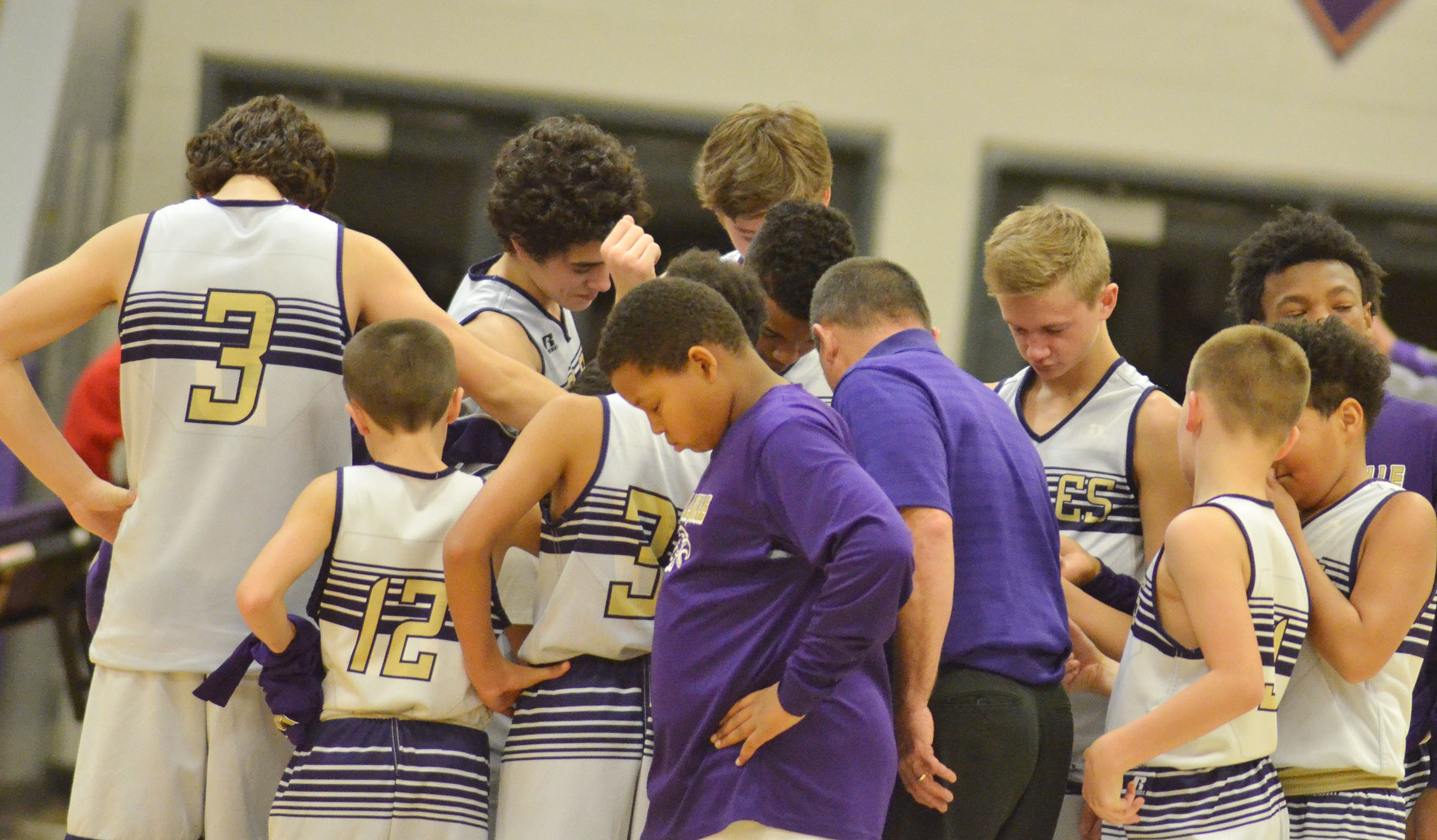 CMS boys' basketball players pray together after their games.