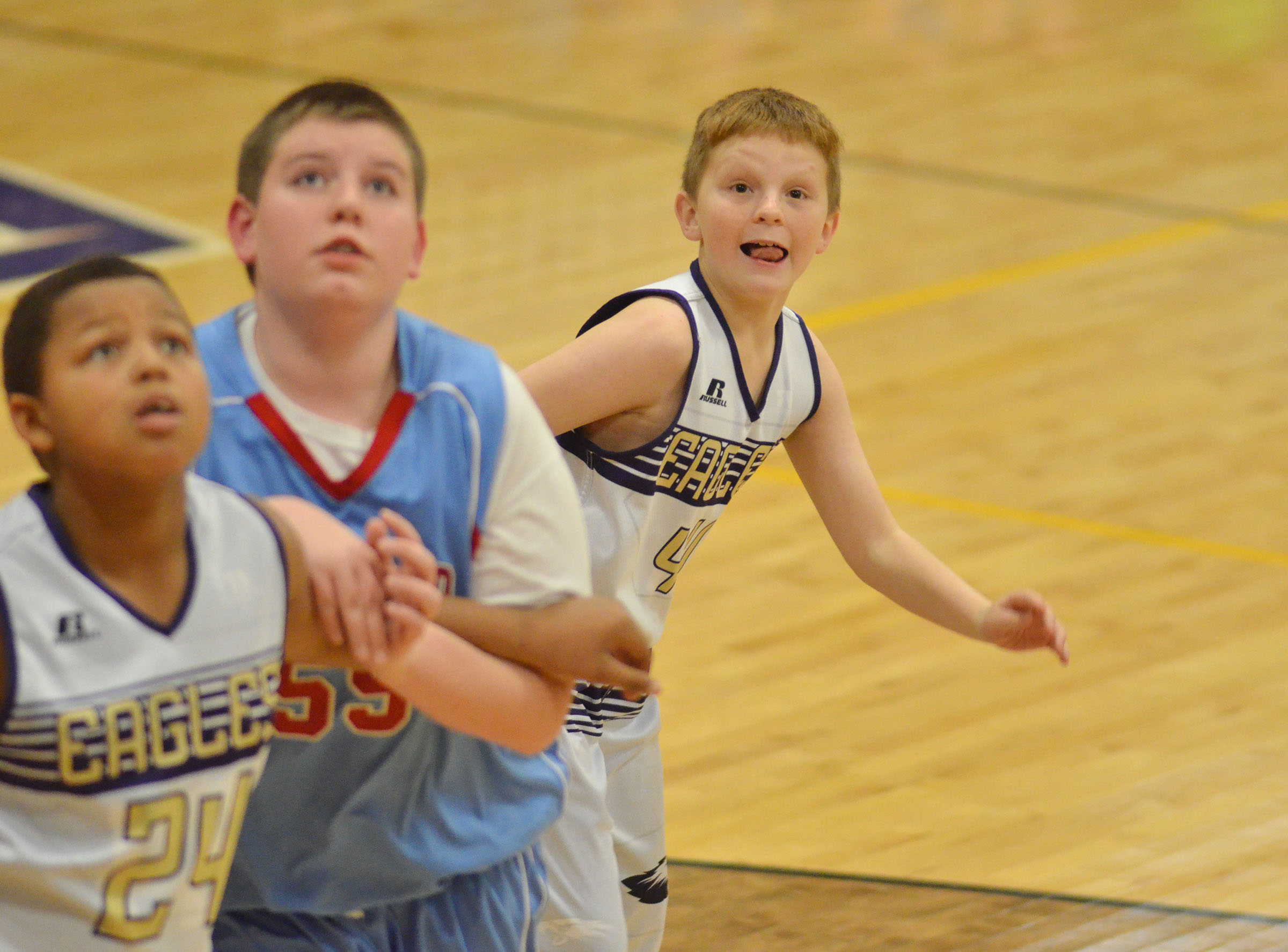 CMS fifth-grader Jason Jeffries looks for a rebound.