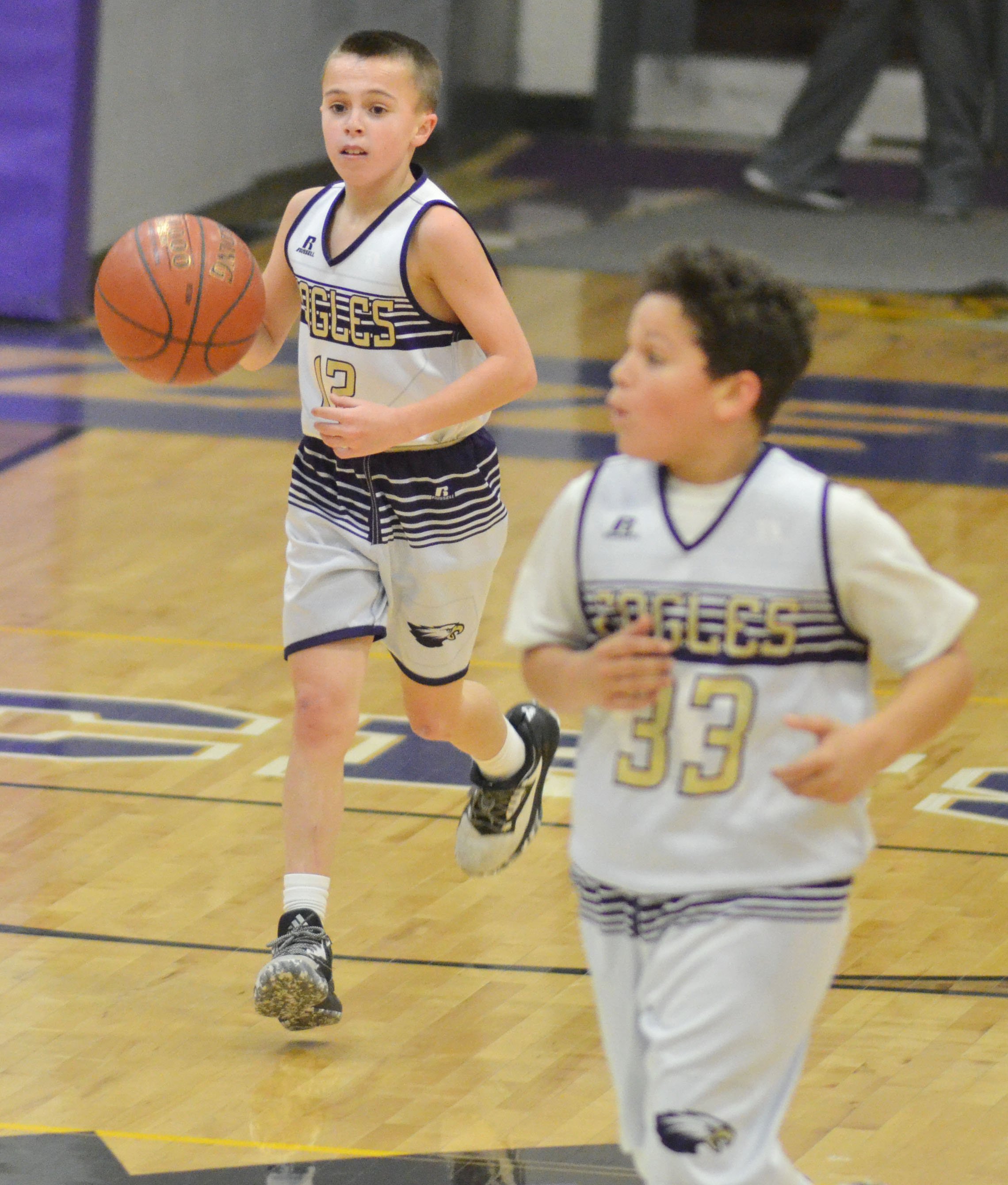 CMS sixth-grader Chase Hord dribbles down the court.