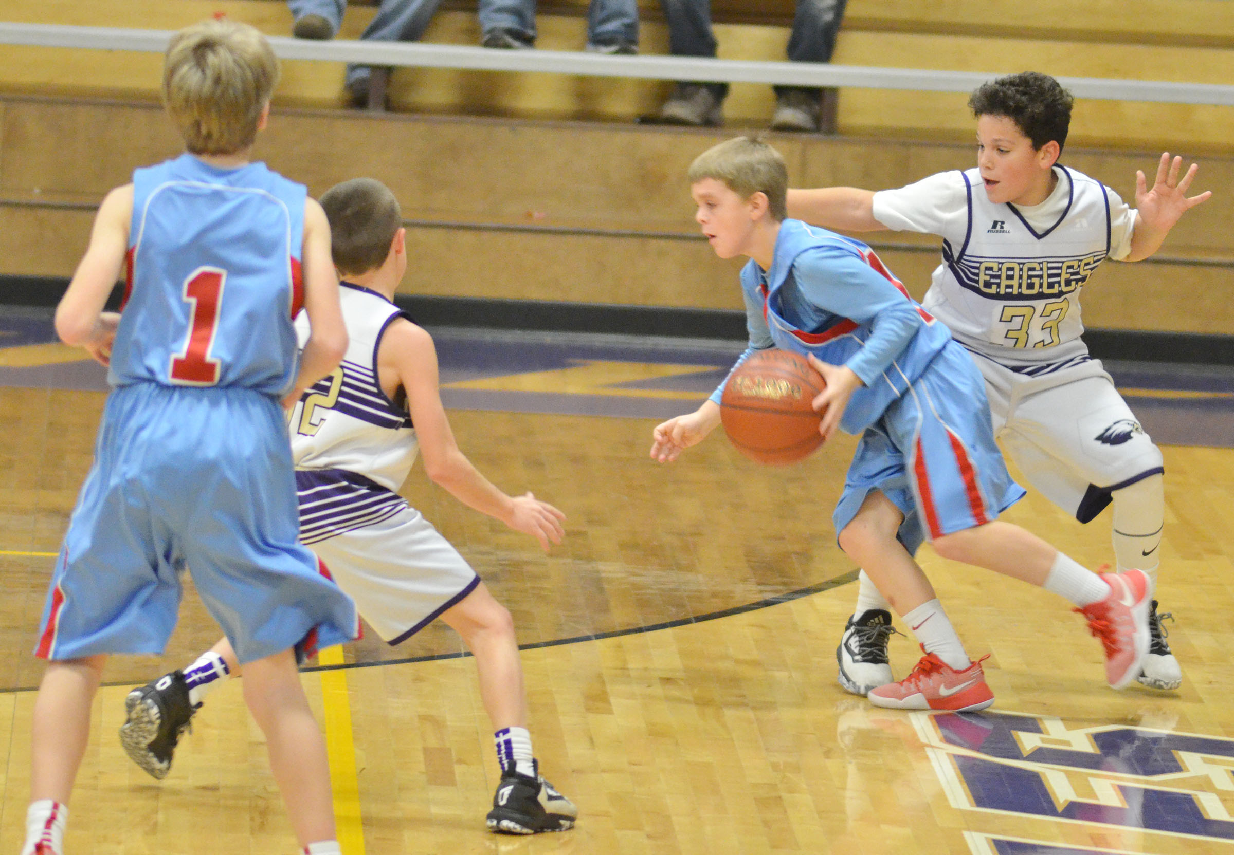 CMS sixth-grader Kaydon Taylor plays defense.