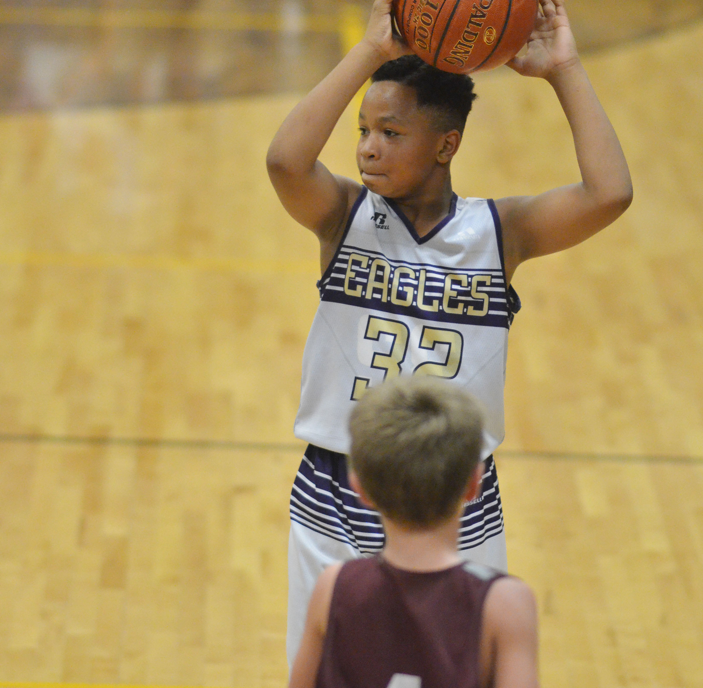 CMS sixth-grader Deondre Weathers looks to pass.