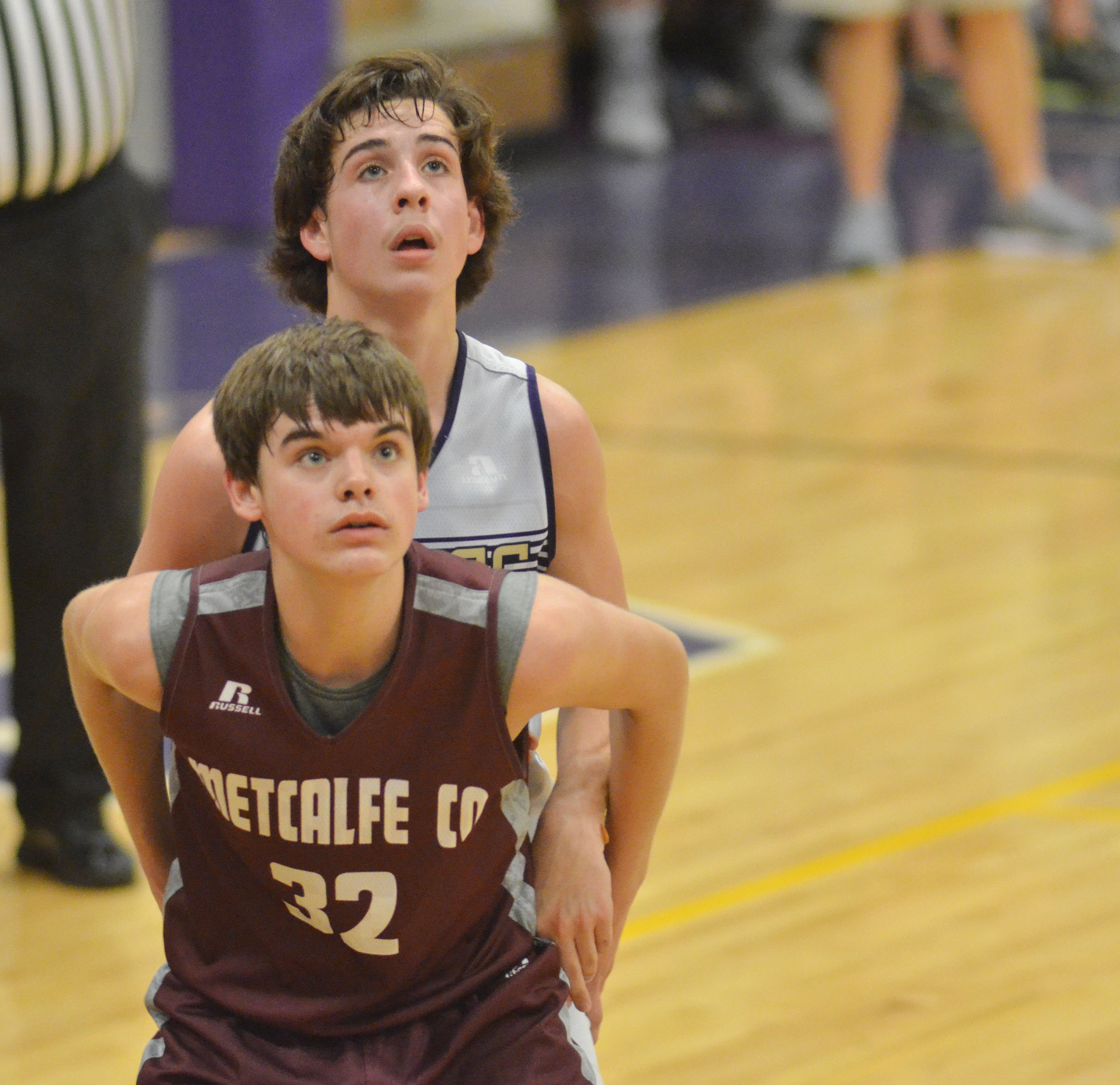 CMS eighth-grader John Orberson battles for the rebound.