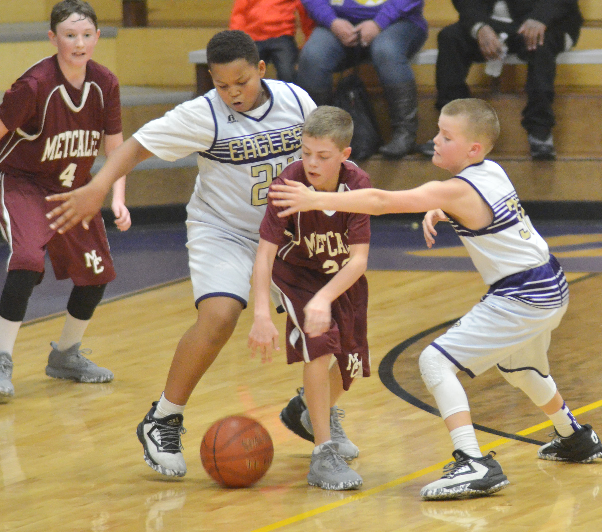CMS sixth-graders Keondre Weathers, at left, and Konner Forbis battle for the ball.