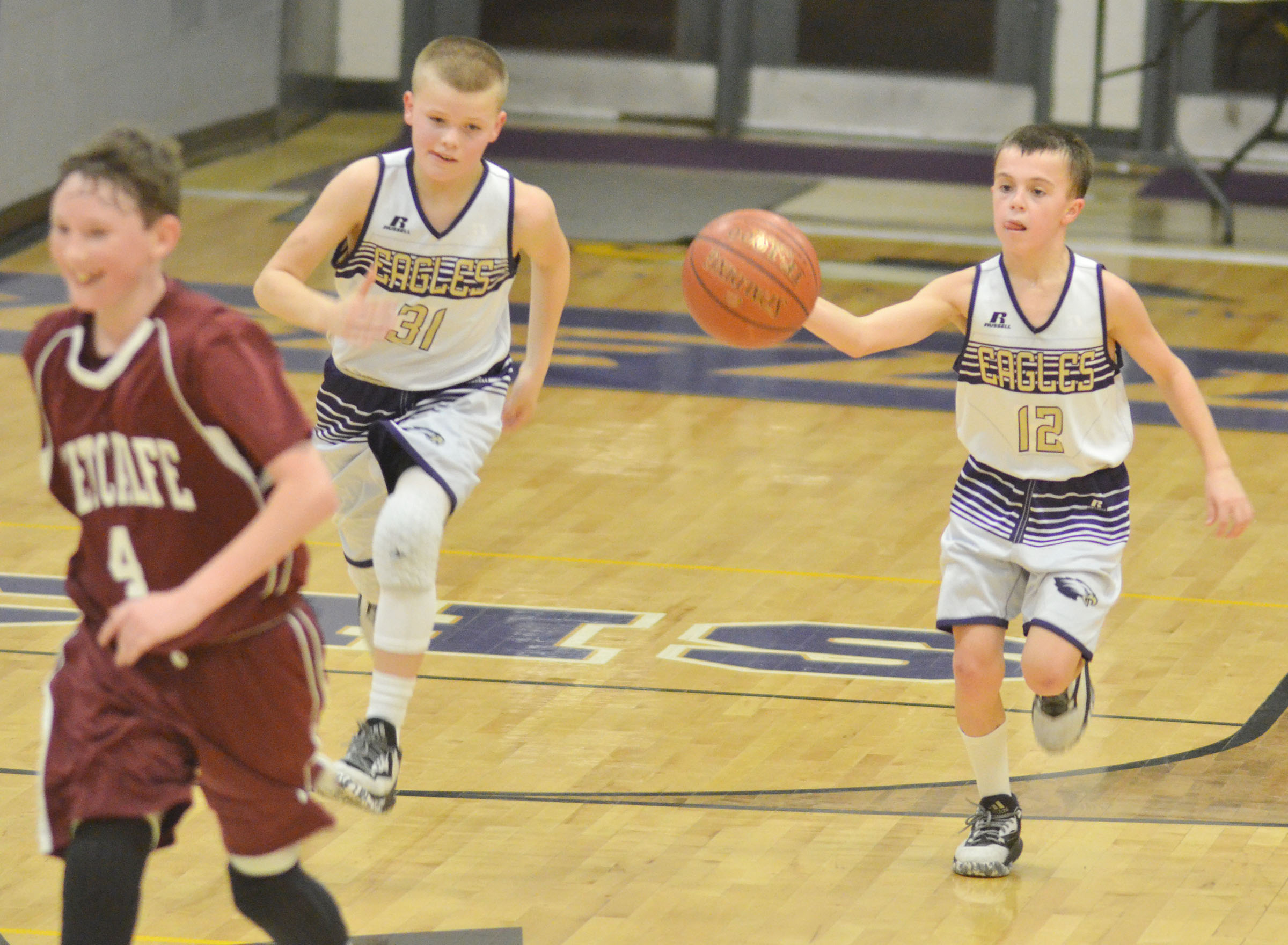 CMS sixth-graders Konner Forbis, at left, and Chase Hord run to the basket.
