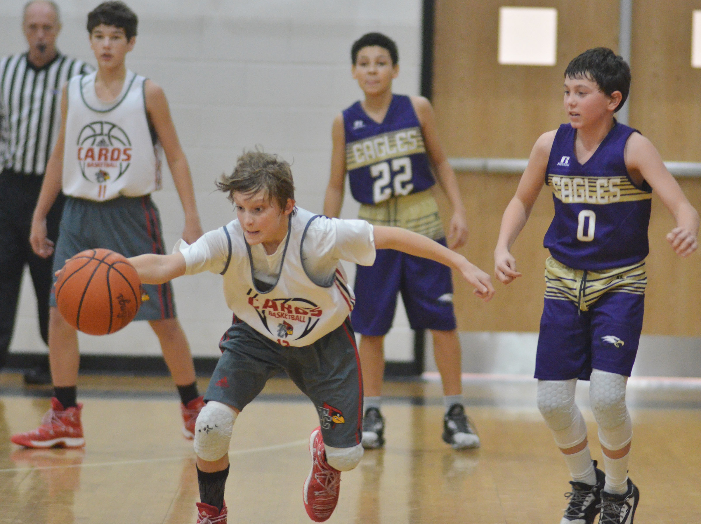 CMS seventh-graders Brice Spaw, at left, and Dakota Harris play defense.