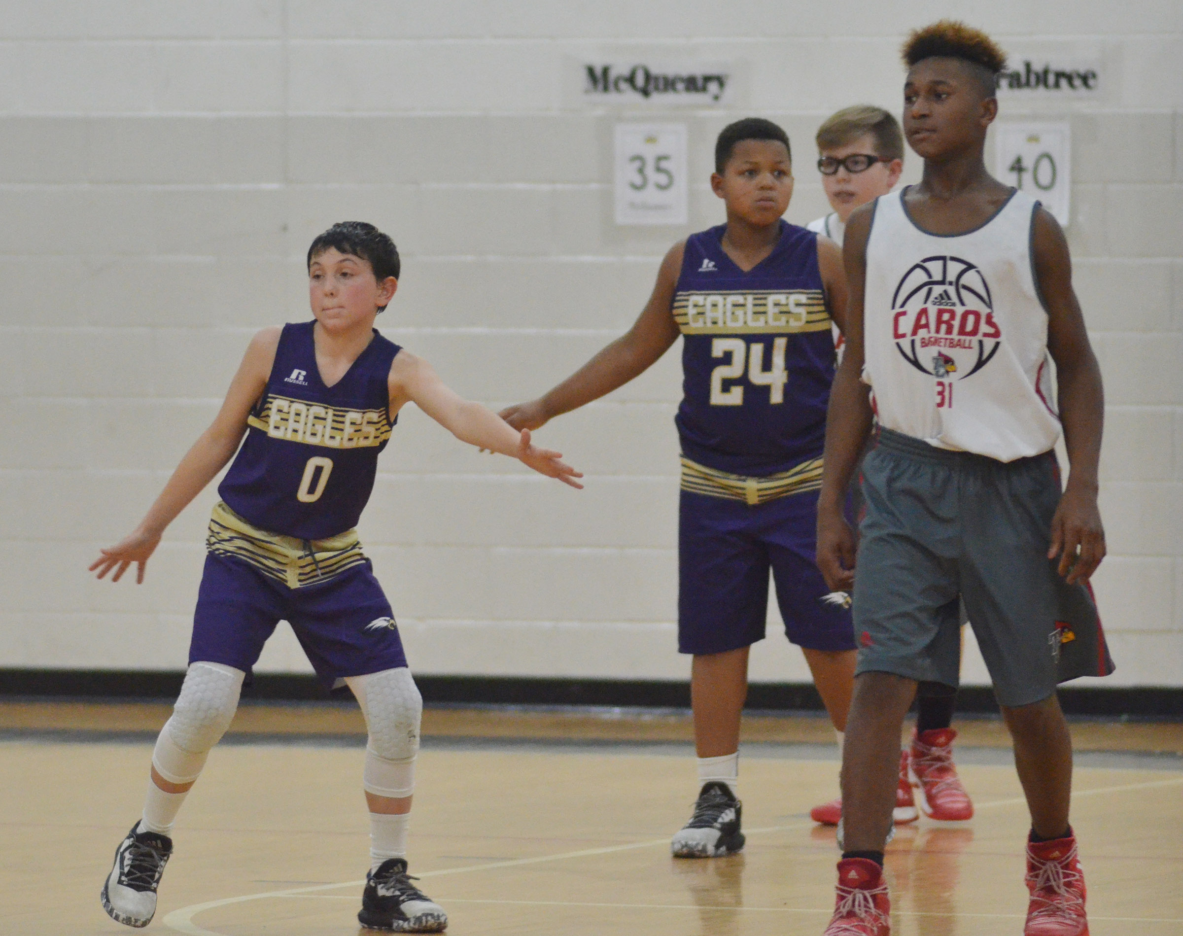 CMS seventh-grader Dakota Harris, at left, and sixth-grader Keondre Weathers play defense.
