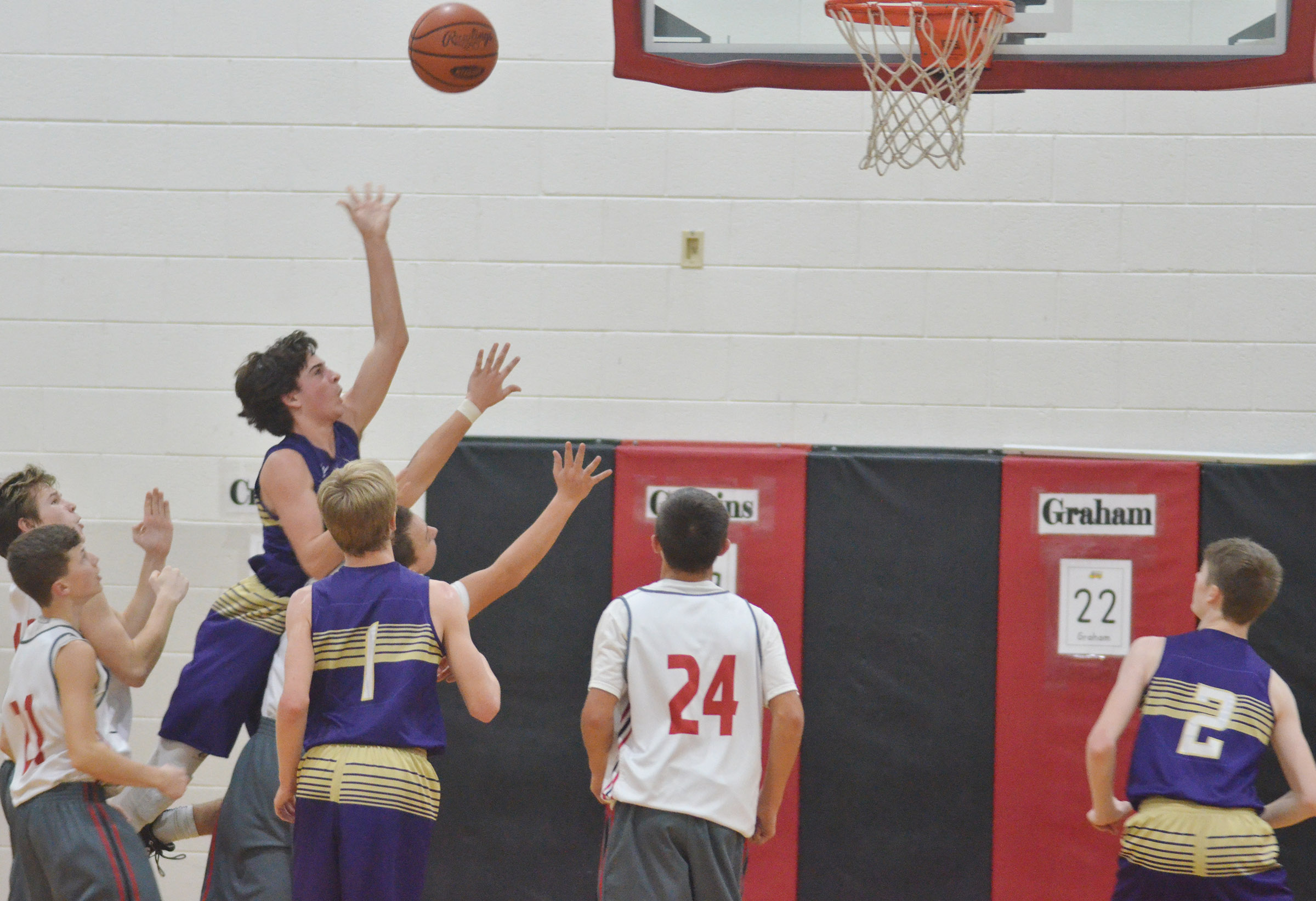 CMS eighth-grader John Orberson shoots the ball.