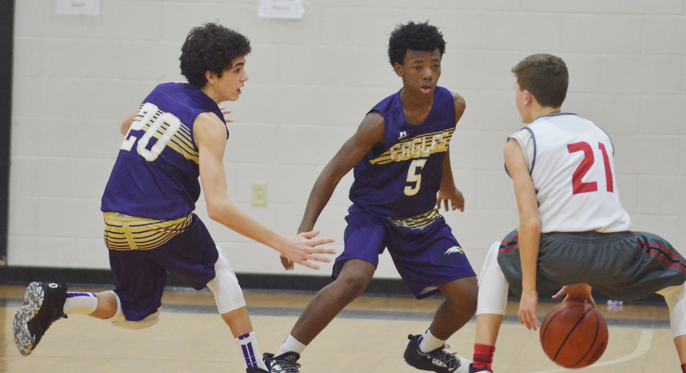 CMS eighth-graders Kameron Smith, at left, and Saevon Buckner play defense.