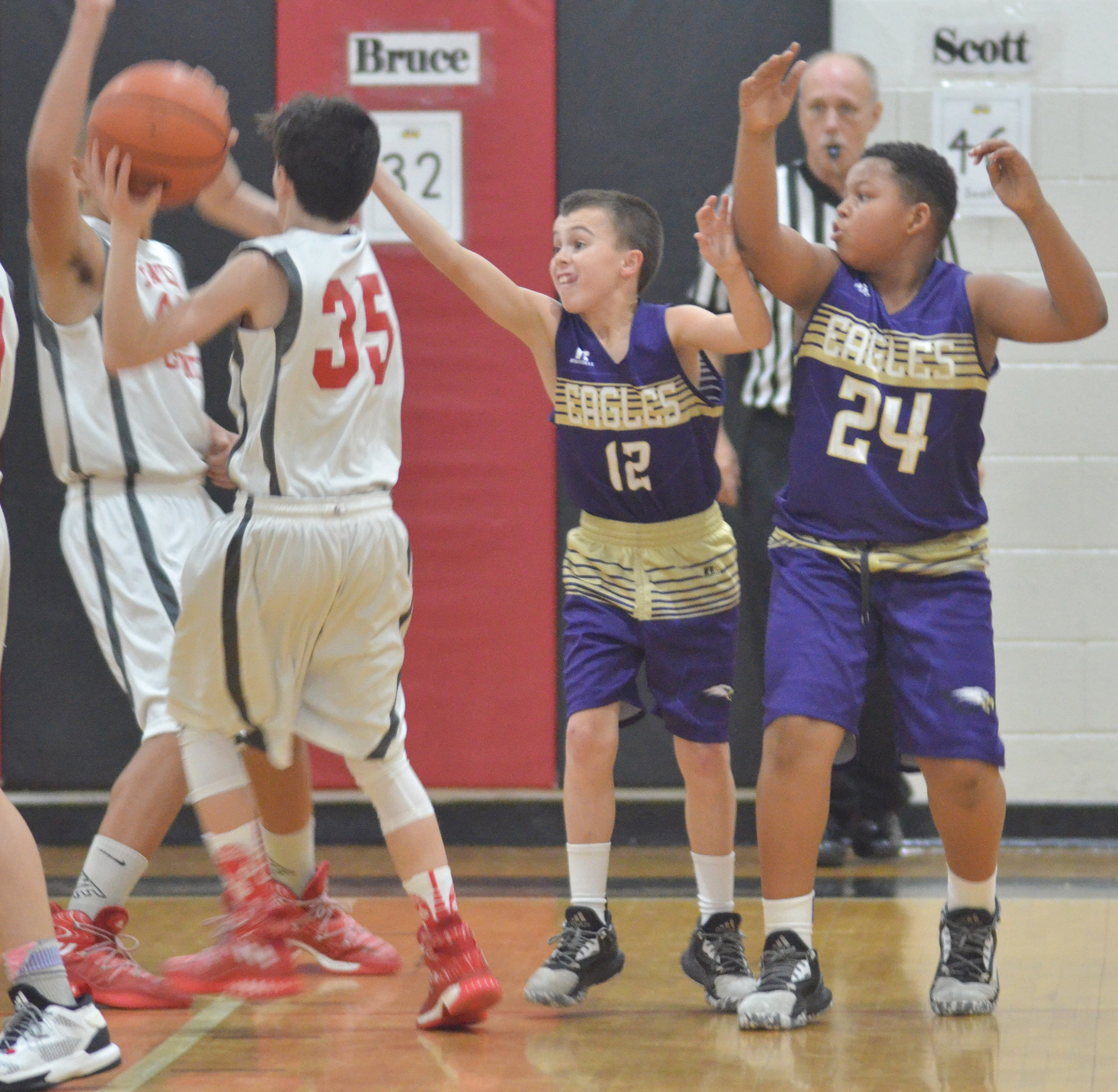 CMS sixth-graders Chase Hord, at left, and Keondre Weathers battle for the ball.