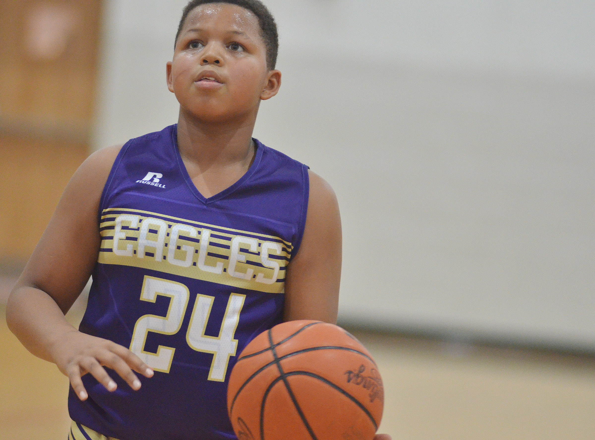 CMS sixth-graders Deondre Weathers shoots the ball.