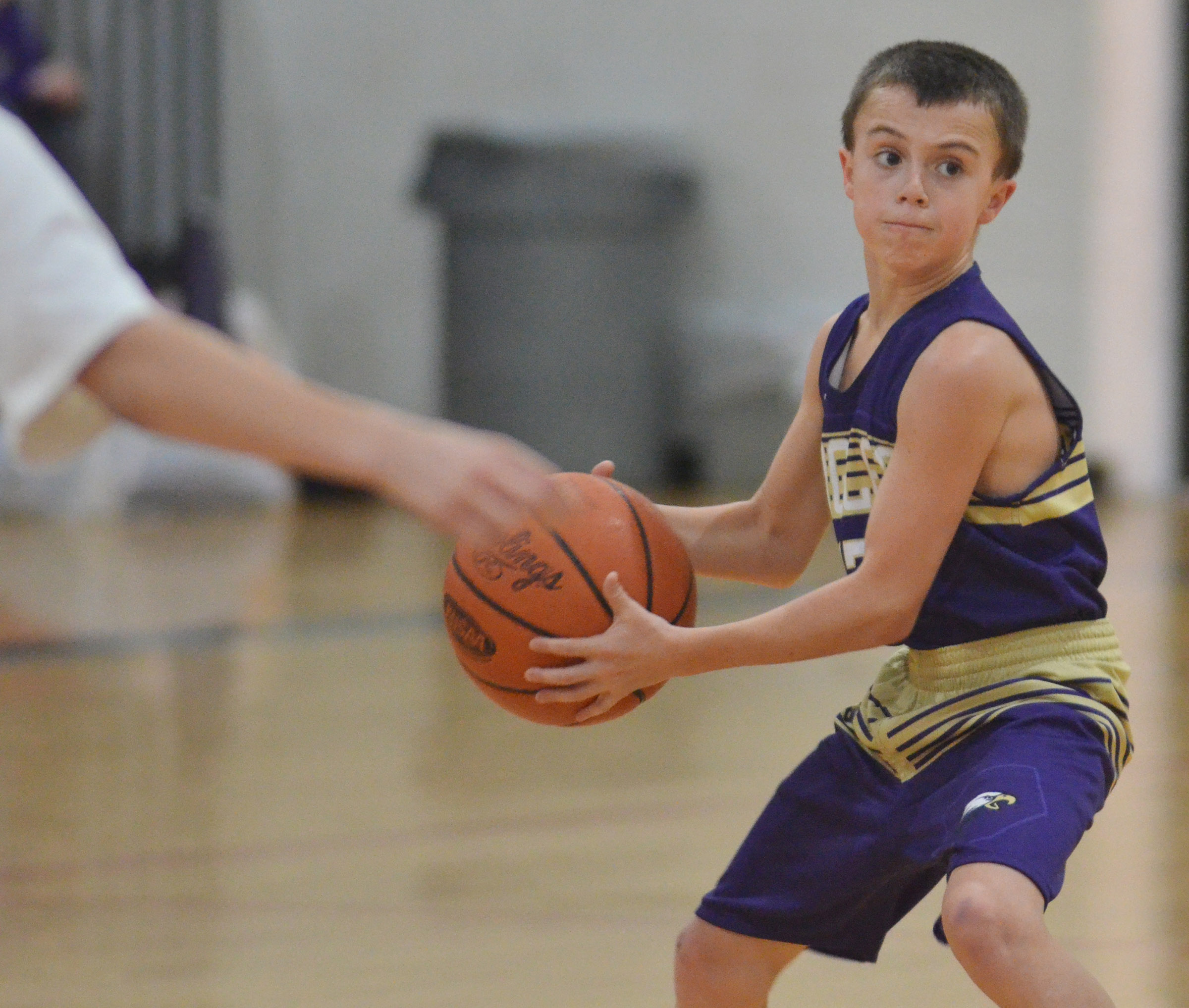 CMS sixth-grader Chase Hord passes the ball.