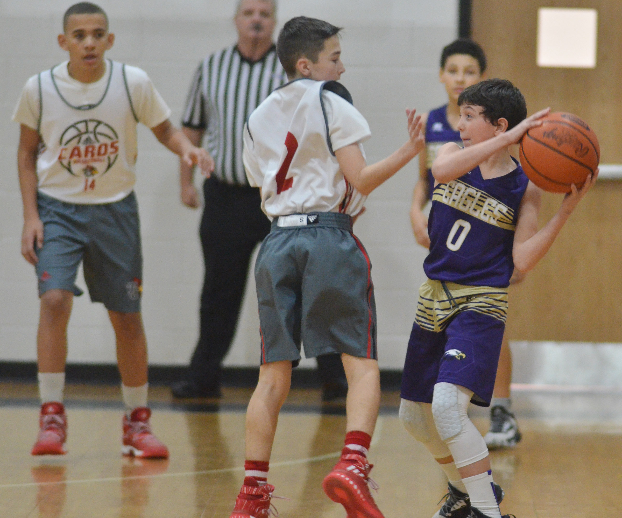 CMS seventh-grader Dakota Harris protects the ball.