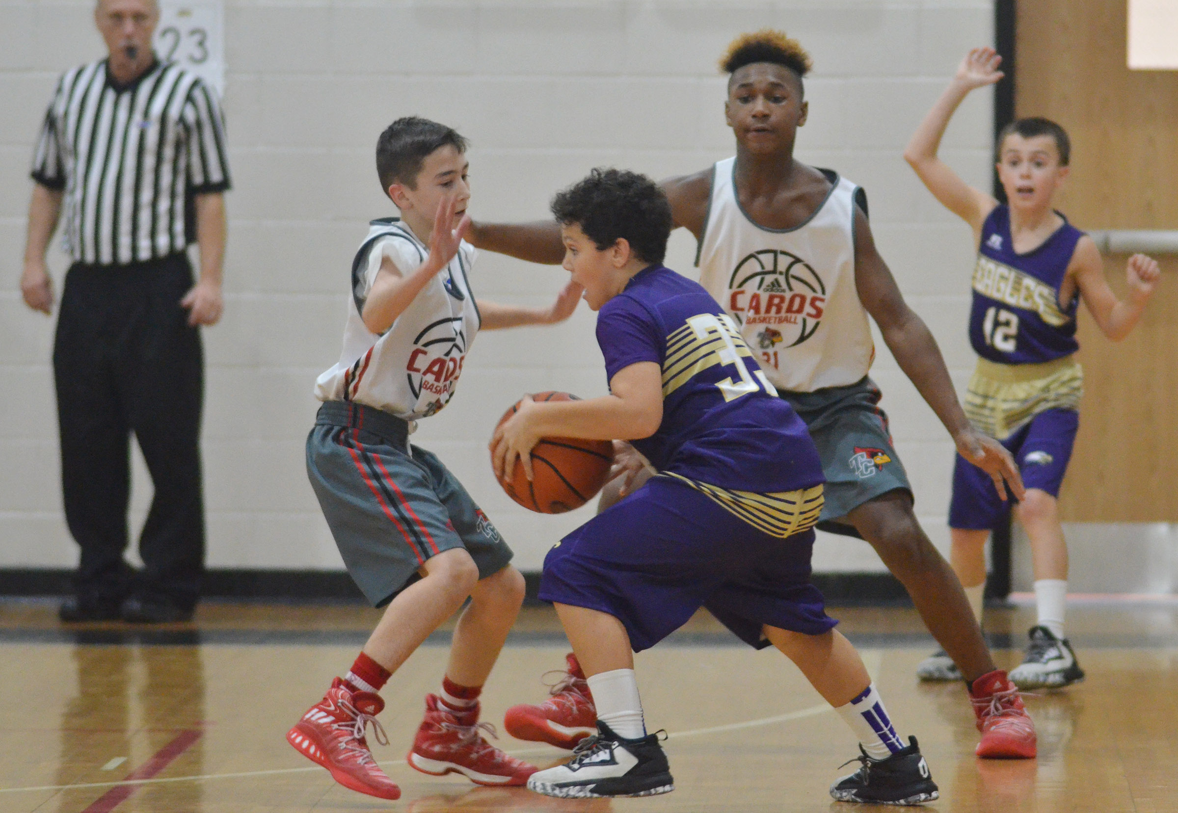 CMS sixth-grader Kaydon Taylor dribbles to the basket.