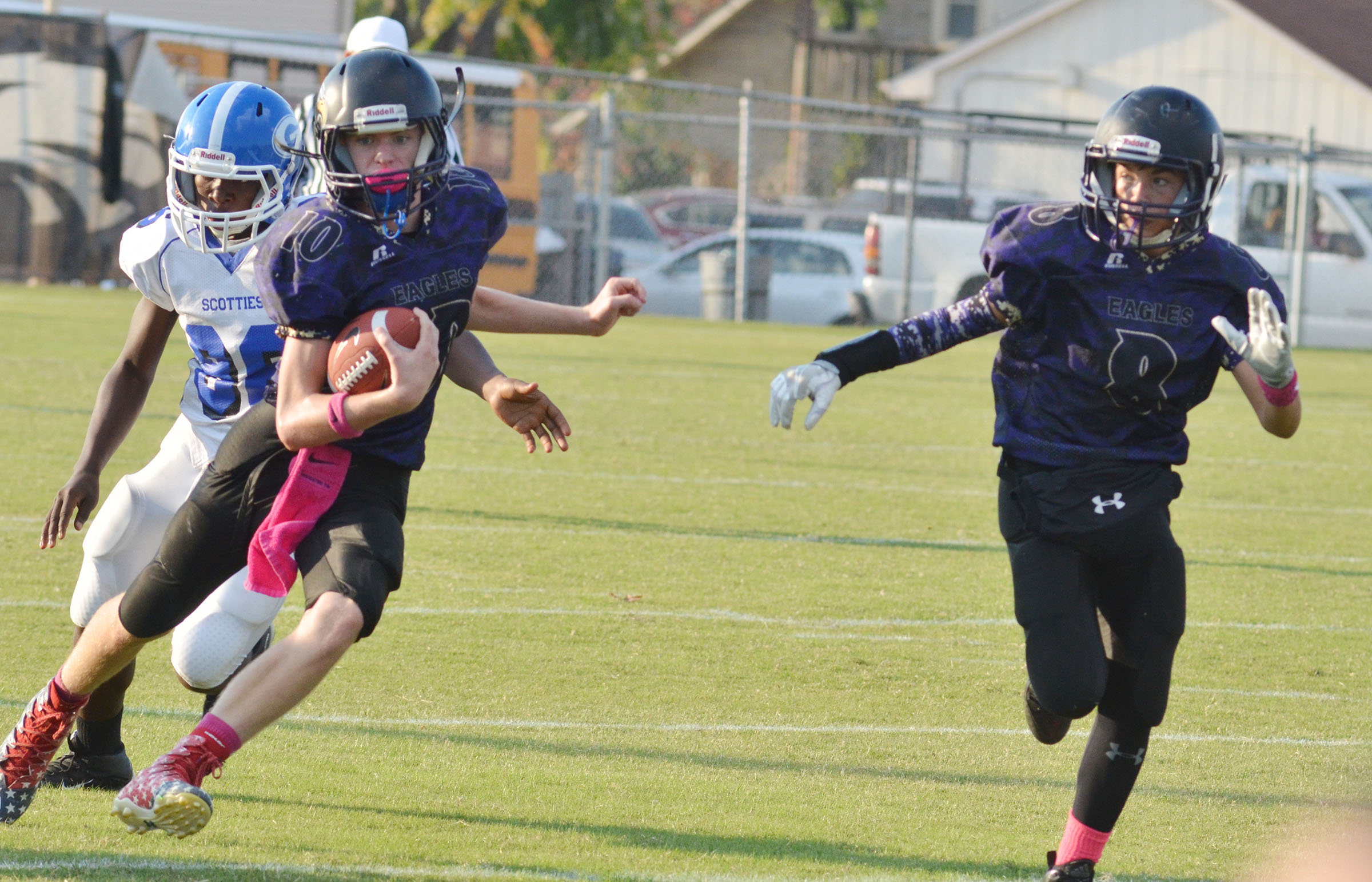 CMS eighth-grader Arren Hash runs the ball as sixth-grader Gavin Oliver gets ready to block.