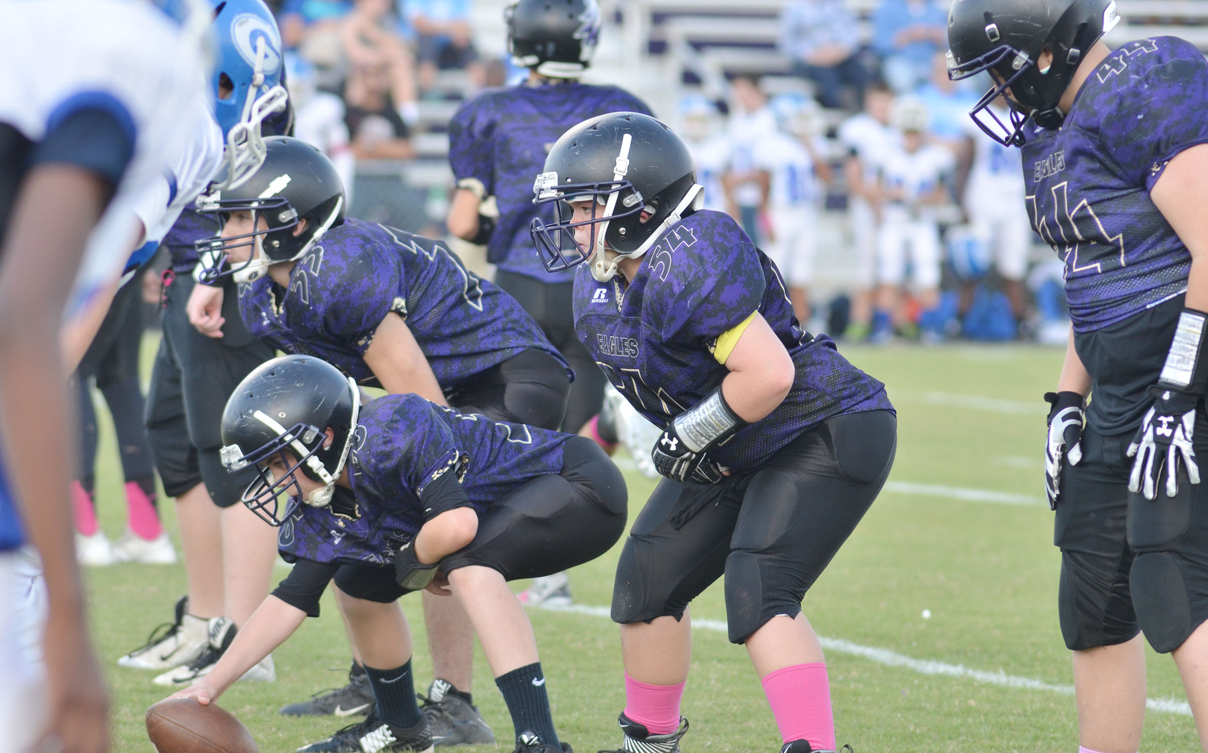 CMS offensive line gets ready for the snap.