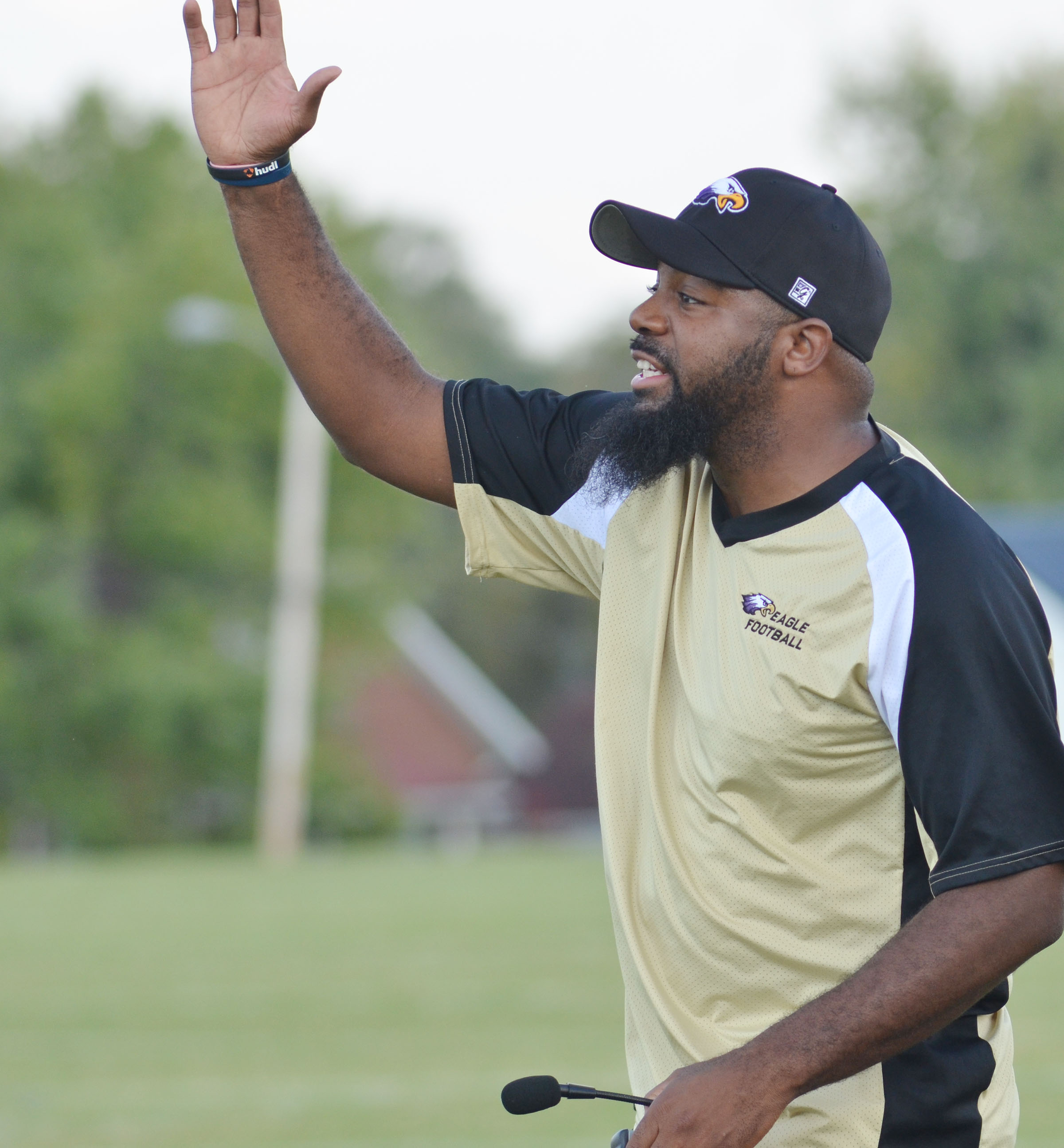 CMS assistant football coach Will Griffin yells to his players.