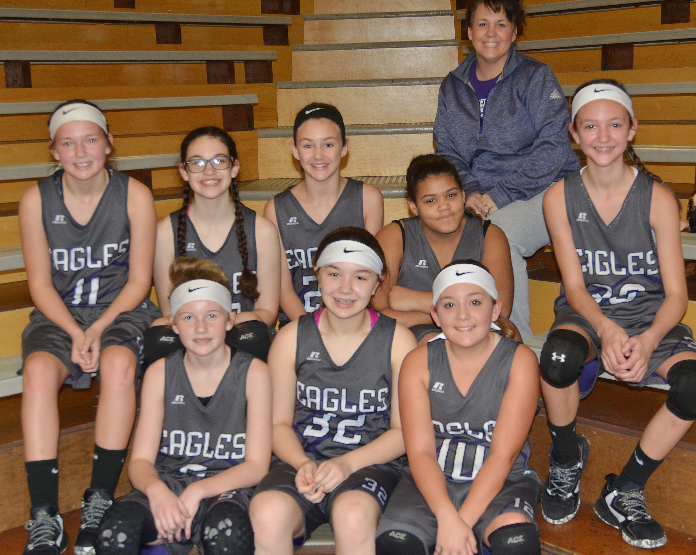 CMS sixth-grade girls' winter basketball team members are, from left, front, sixth-grader Dakota Slone, seventh-grader Olivia Fields and sixth-grader Briana Davis. Back, sixth-graders Breanna Humphress, Mary Russell, Haylee Allen, Asia Barbour and Bri Hayes. In back is coach Kathy England.