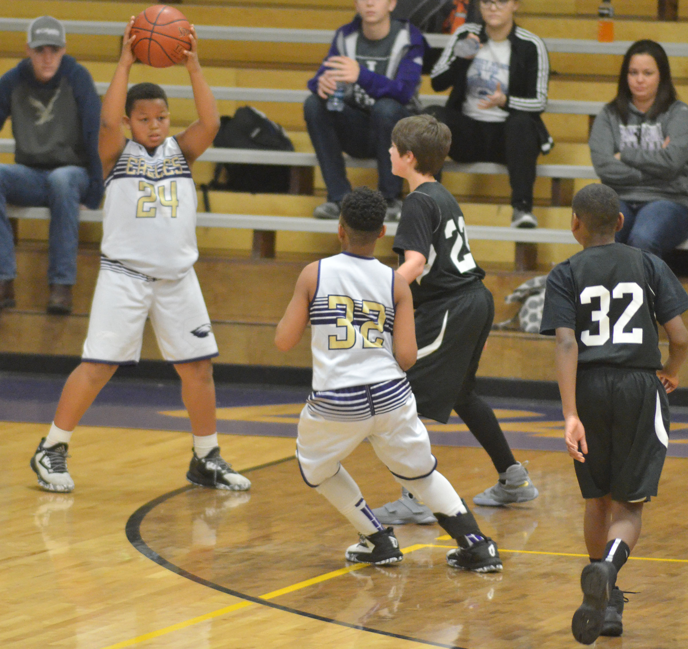 CMS sixth-grader Keondre Weathers passes the ball to his twin brother, Deondre.