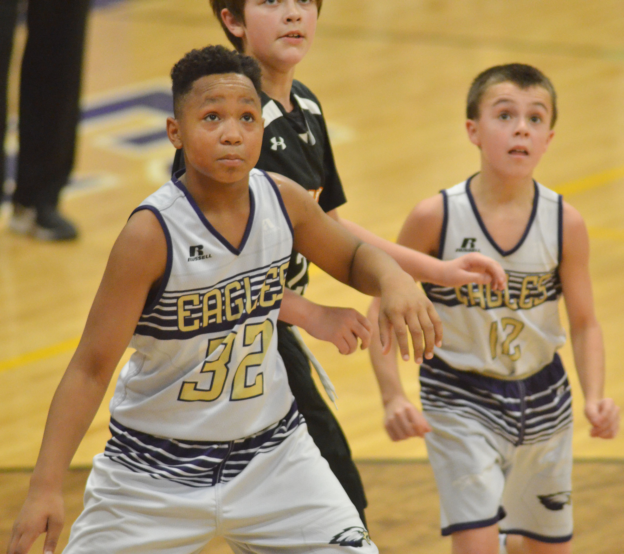 CMS sixth-grader Deondre Weathers looks for a rebound.