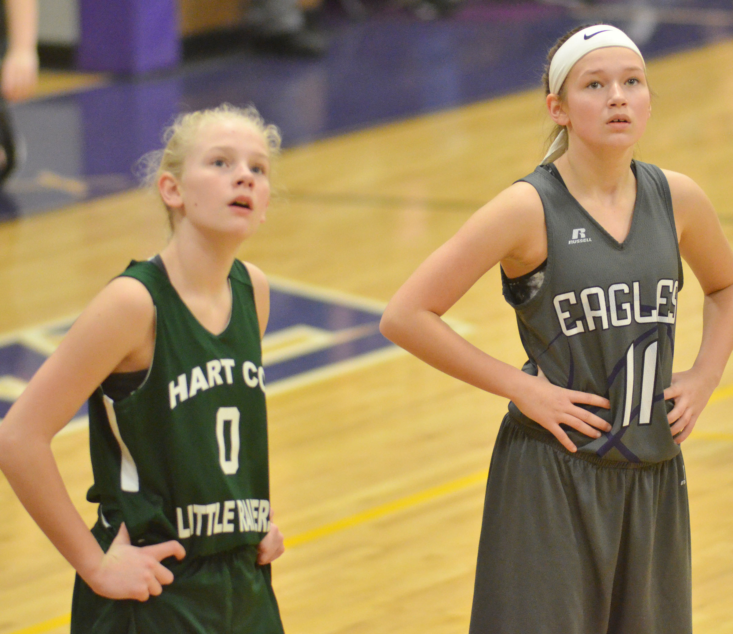 CMS sixth-grader Breanna Humphress watches as her teammate shoots the ball.