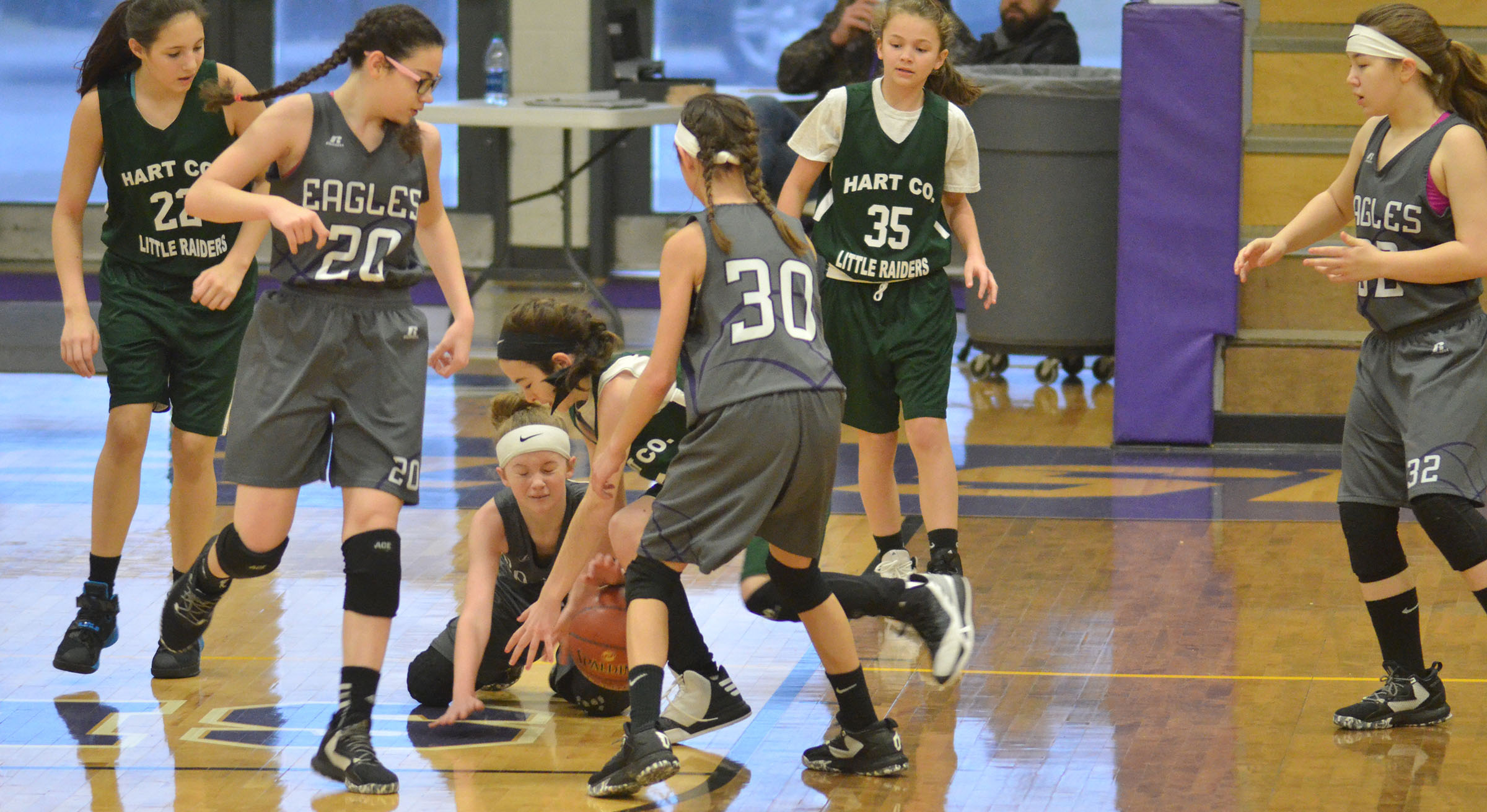 CMS sixth-graders, from left, Mary Russell, Dakota Slone and Bri Hayes battle for the ball.