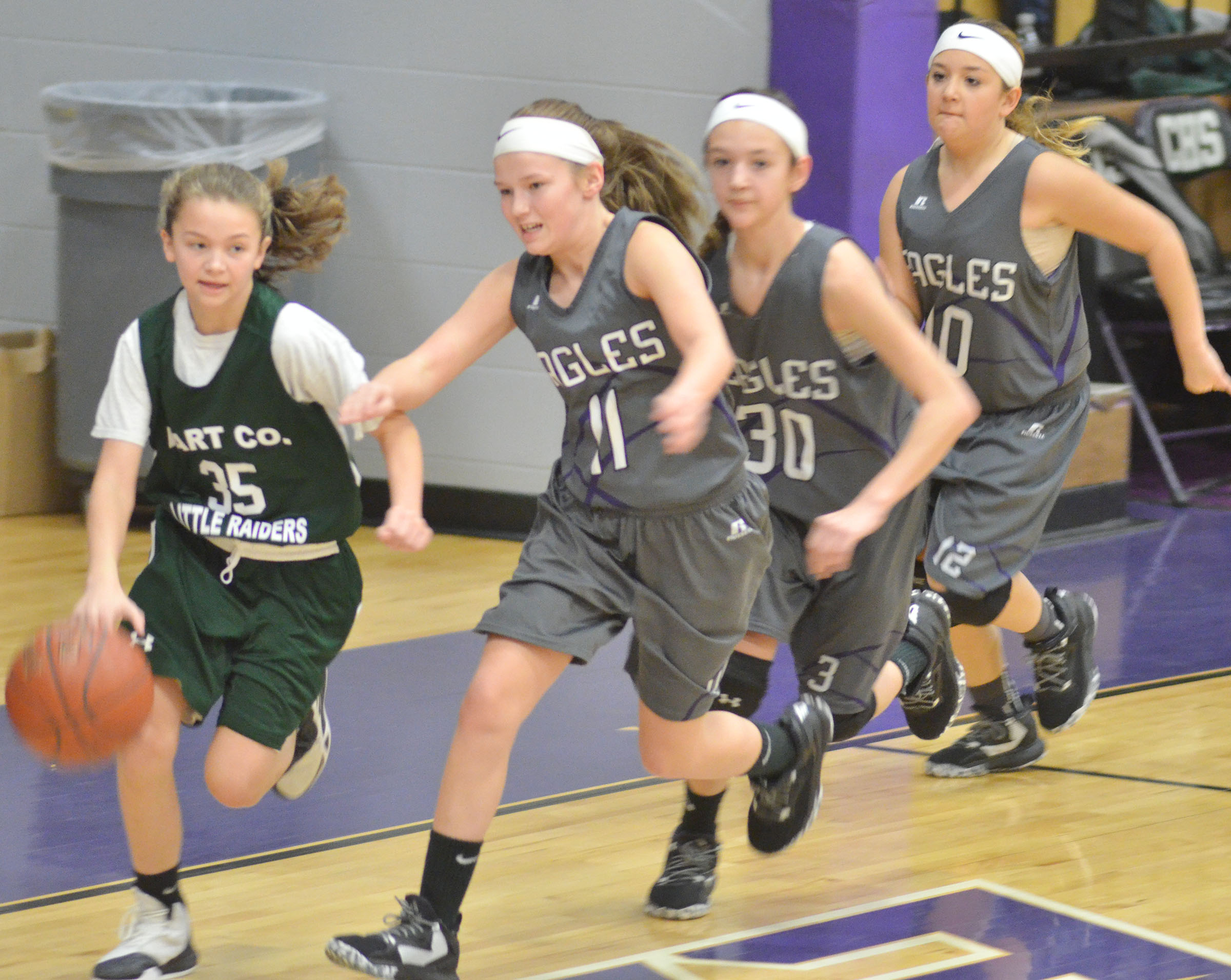 CMS sixth-graders, from left, Breanna Humphress, Bri Hayes and Briana Davis run to the basket.
