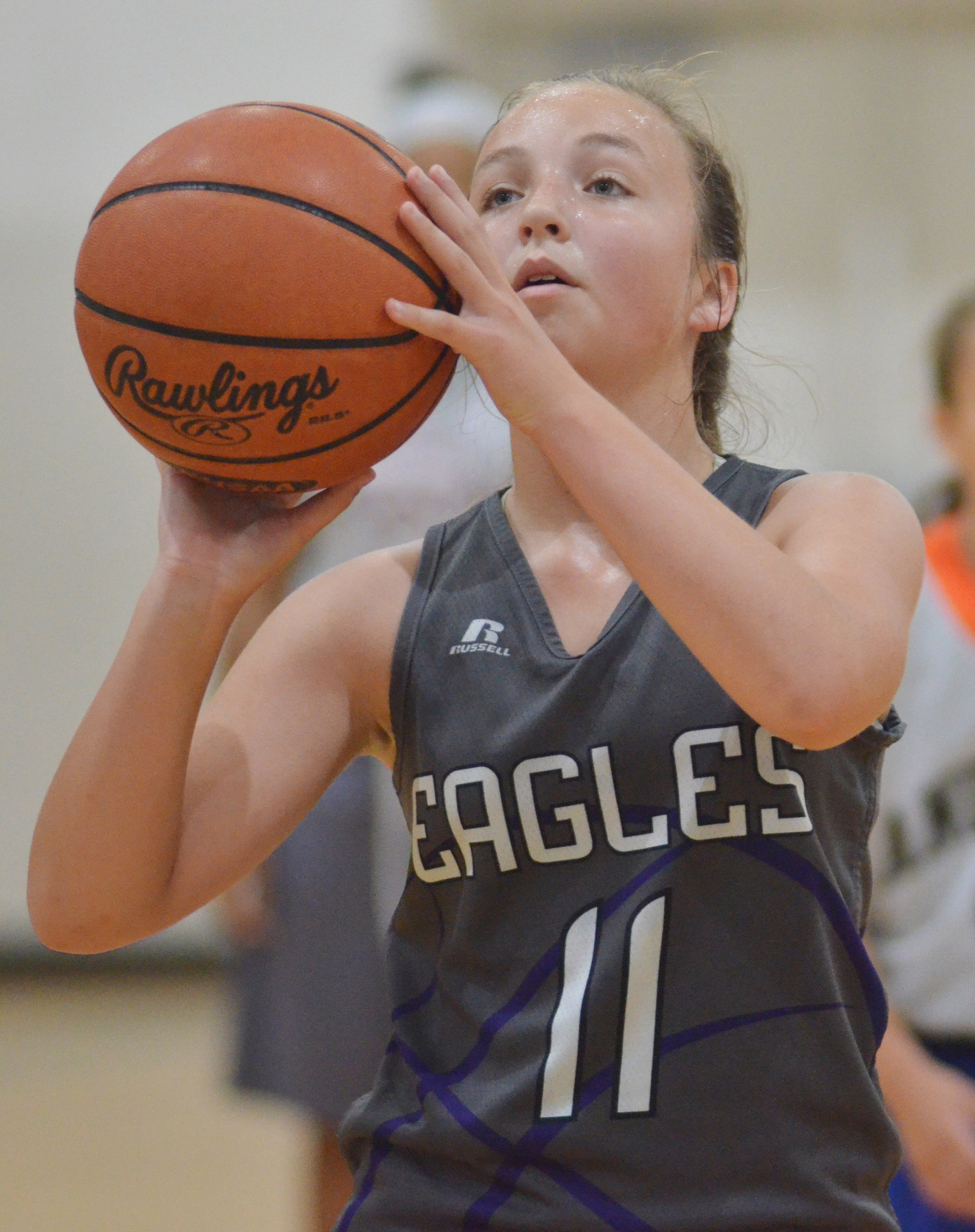 CMS eighth-grader Lainey Watson shoots the ball.