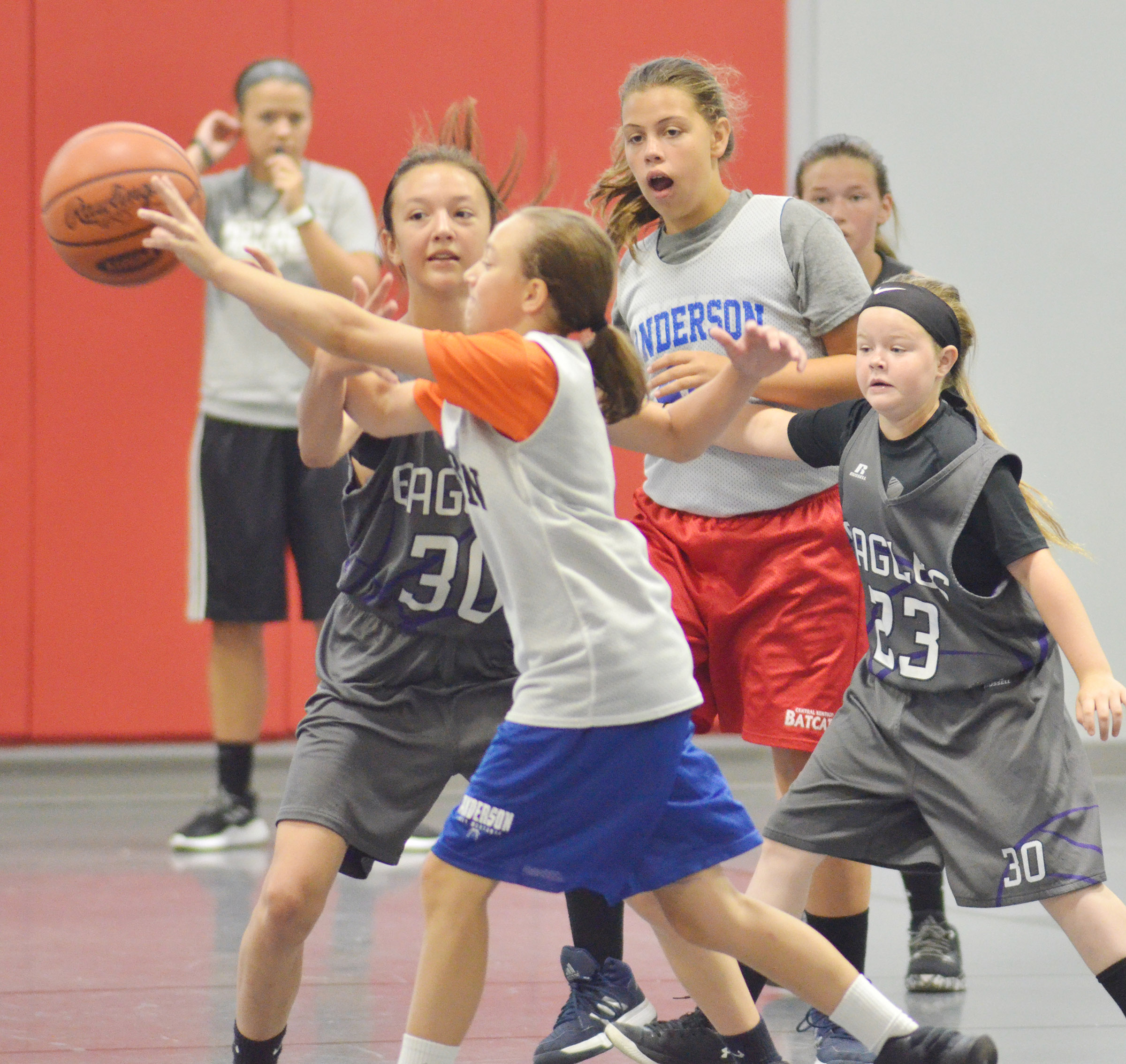 CMS seventh-grader Bri Hayes, at left, and fifth-grader Miley Hash play defense.