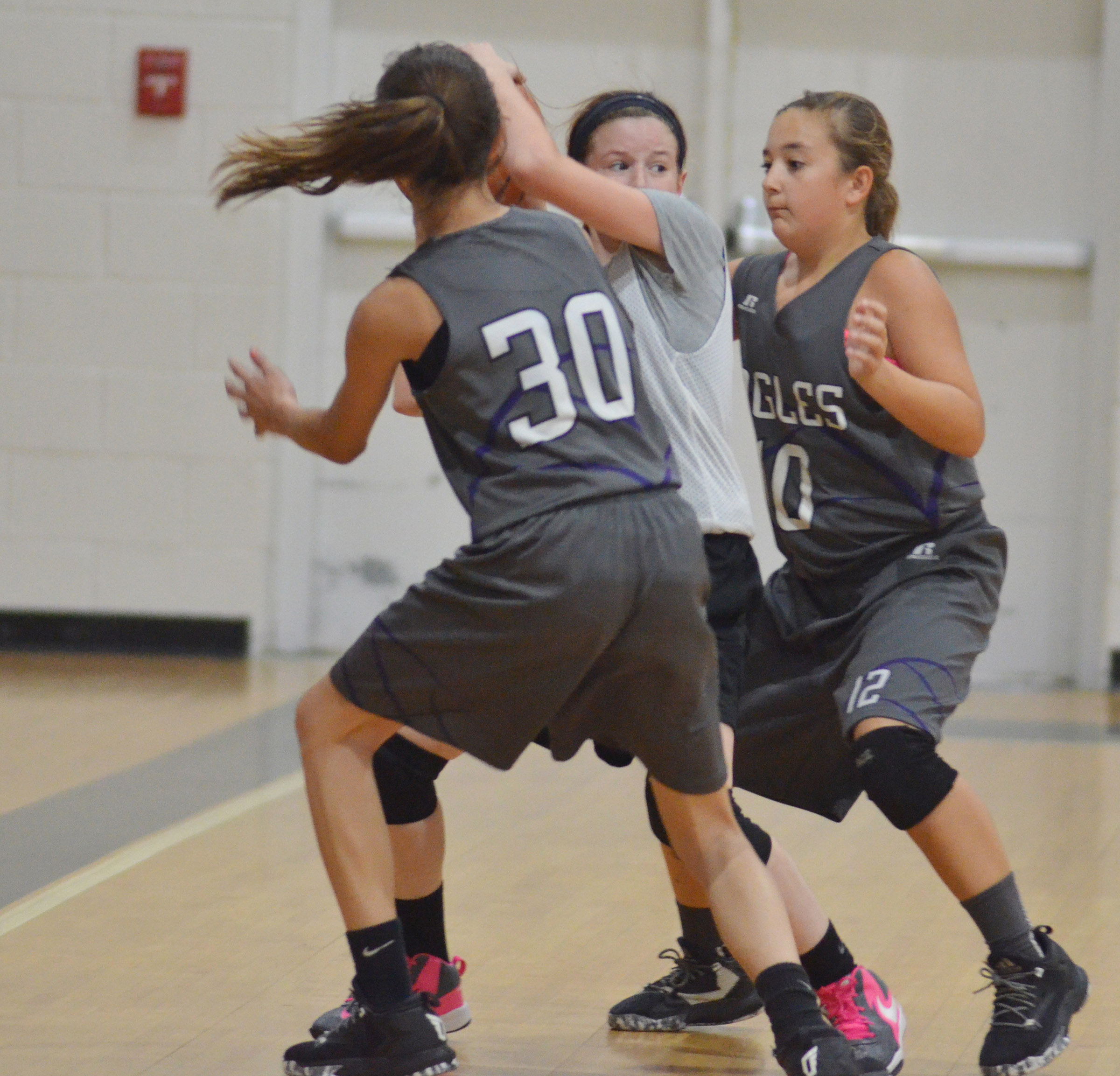 CMS seventh-graders Bri Hayes, at left, and Briana Davis battle for the ball.