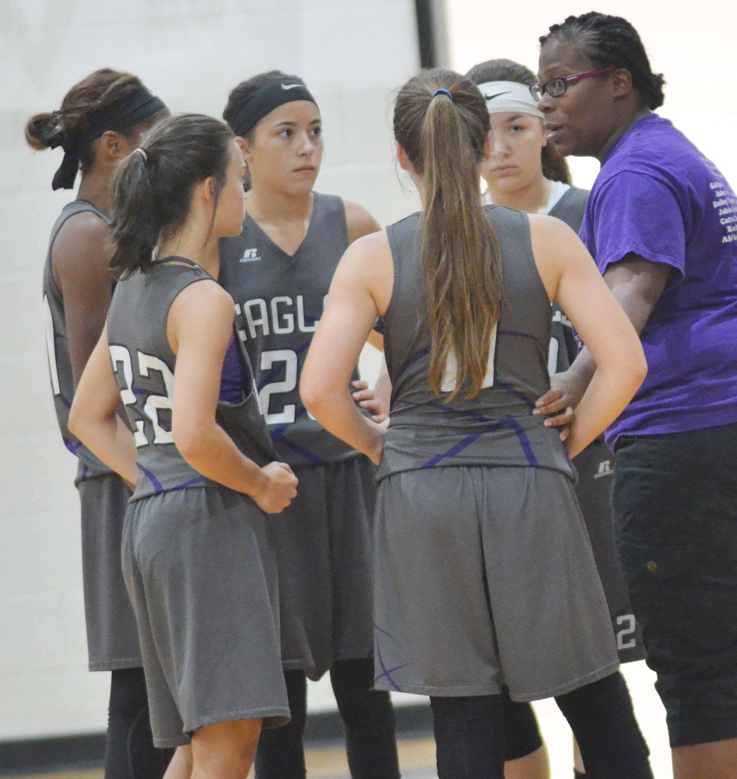 CMS girls' basketball head coach Tiara Cecil talks to her players.