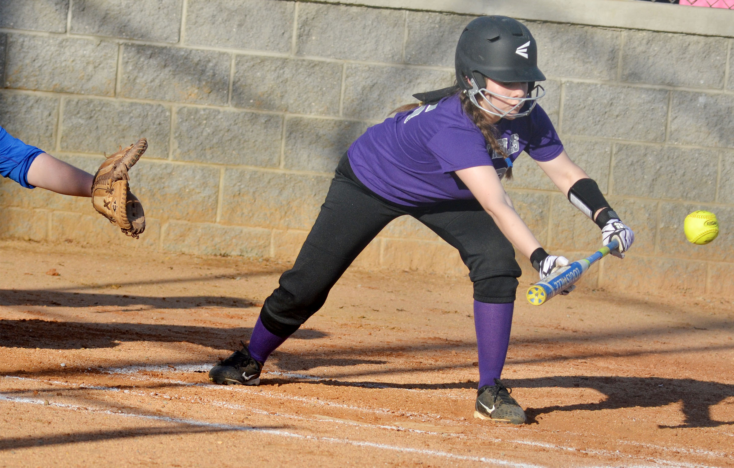 CMS eighth-grader Kaylee Reynolds bunts.