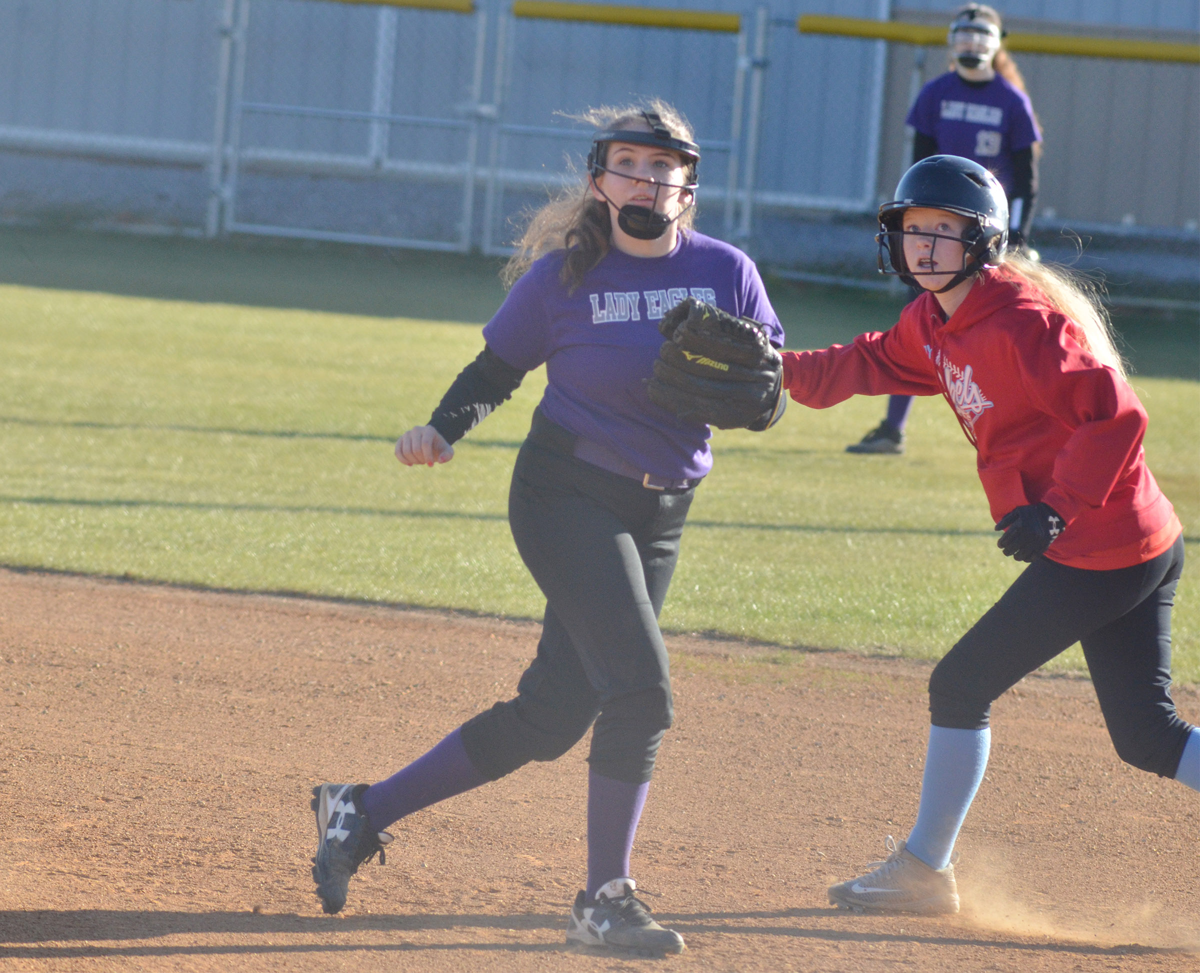 CMS eighth-grader Kaylee Reynolds holds the runner on first.