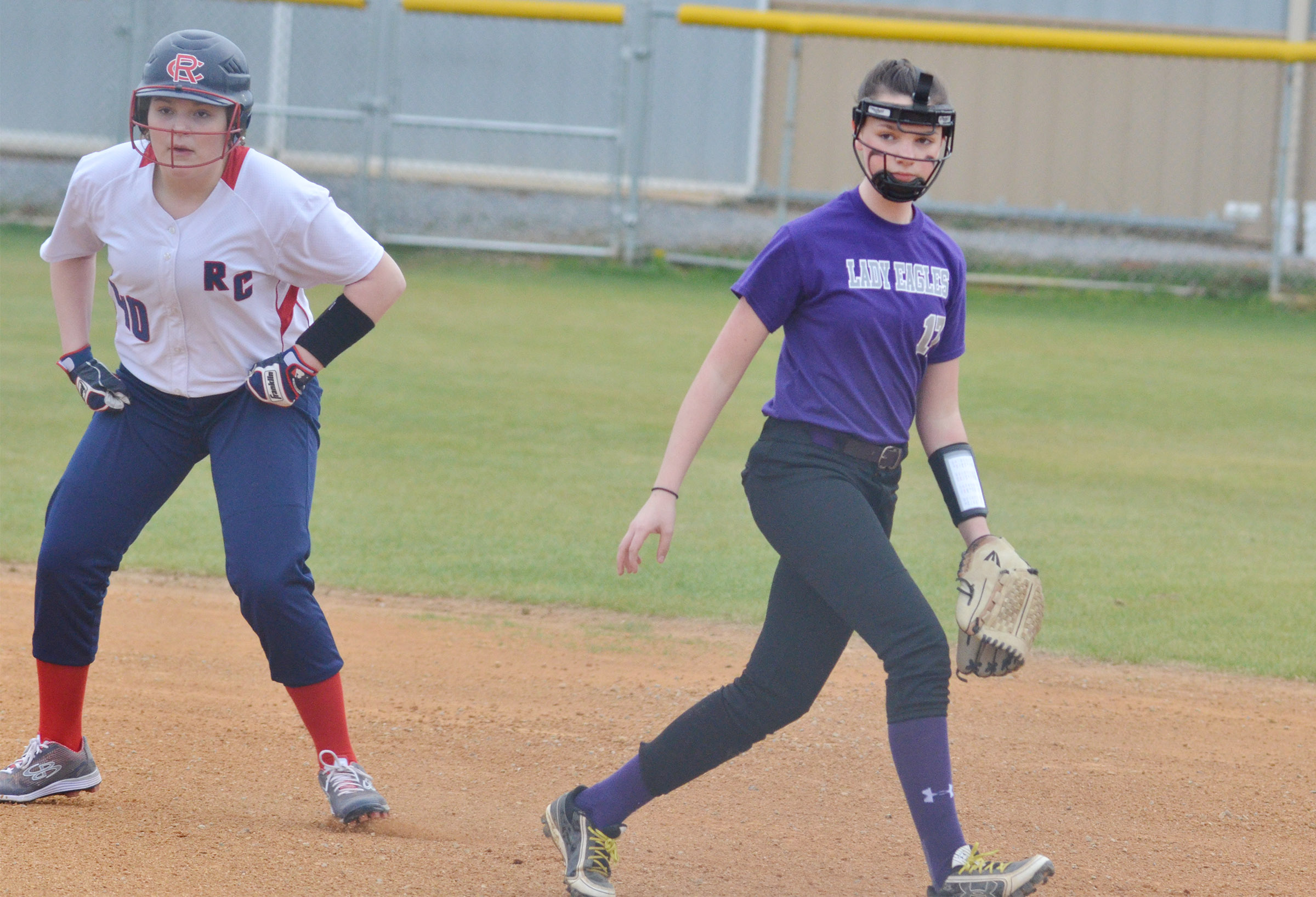 CMS seventh-grader Karley Morris keeps the runner on first.