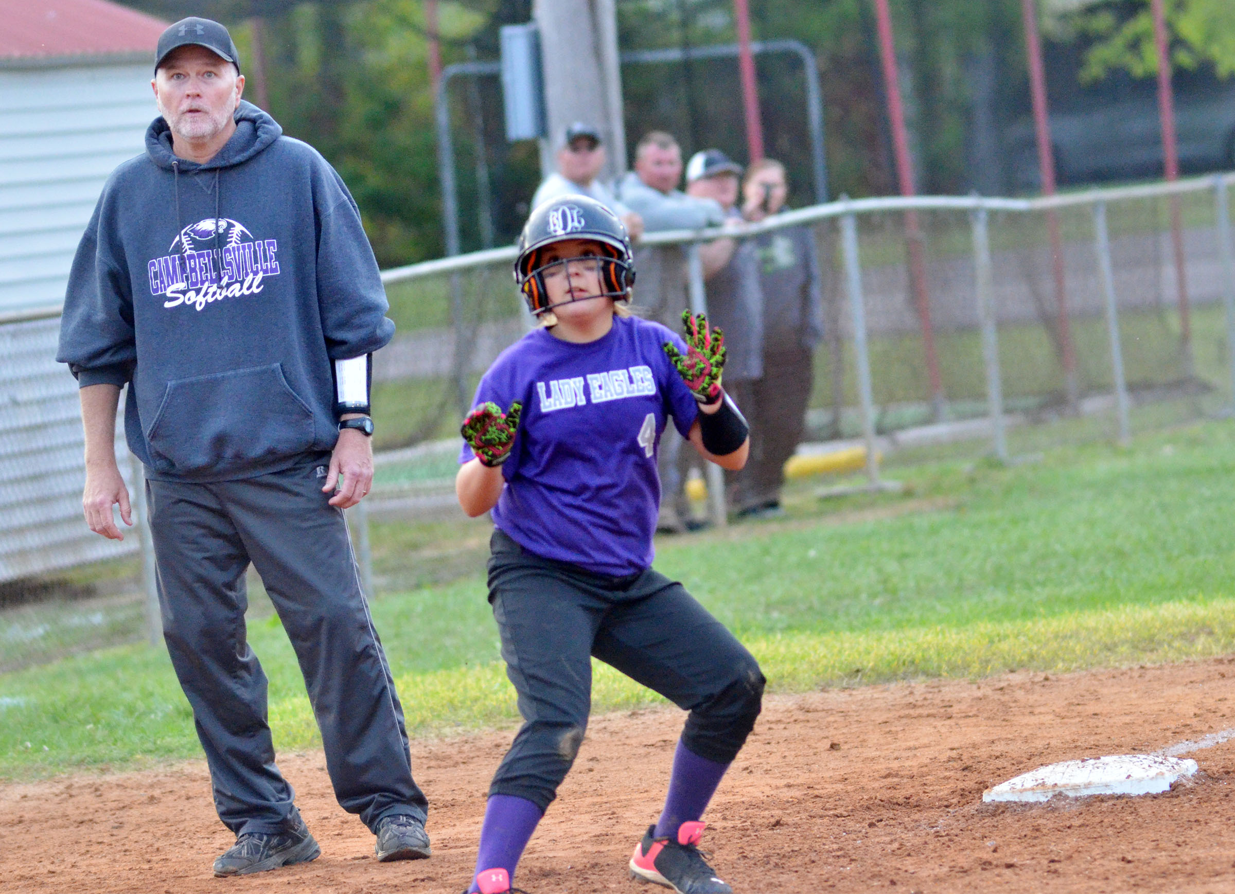 CMS sixth-grader Briana Davis watches the ball before running home.