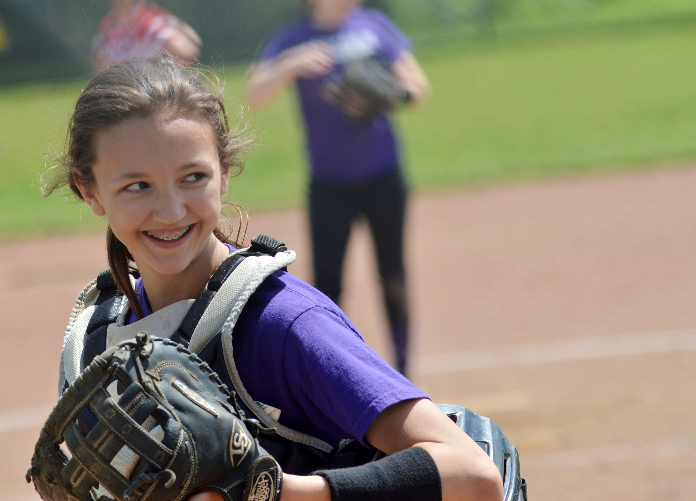 CMS sixth-grader Bri Hayes smiles as her team warms up before the B game.