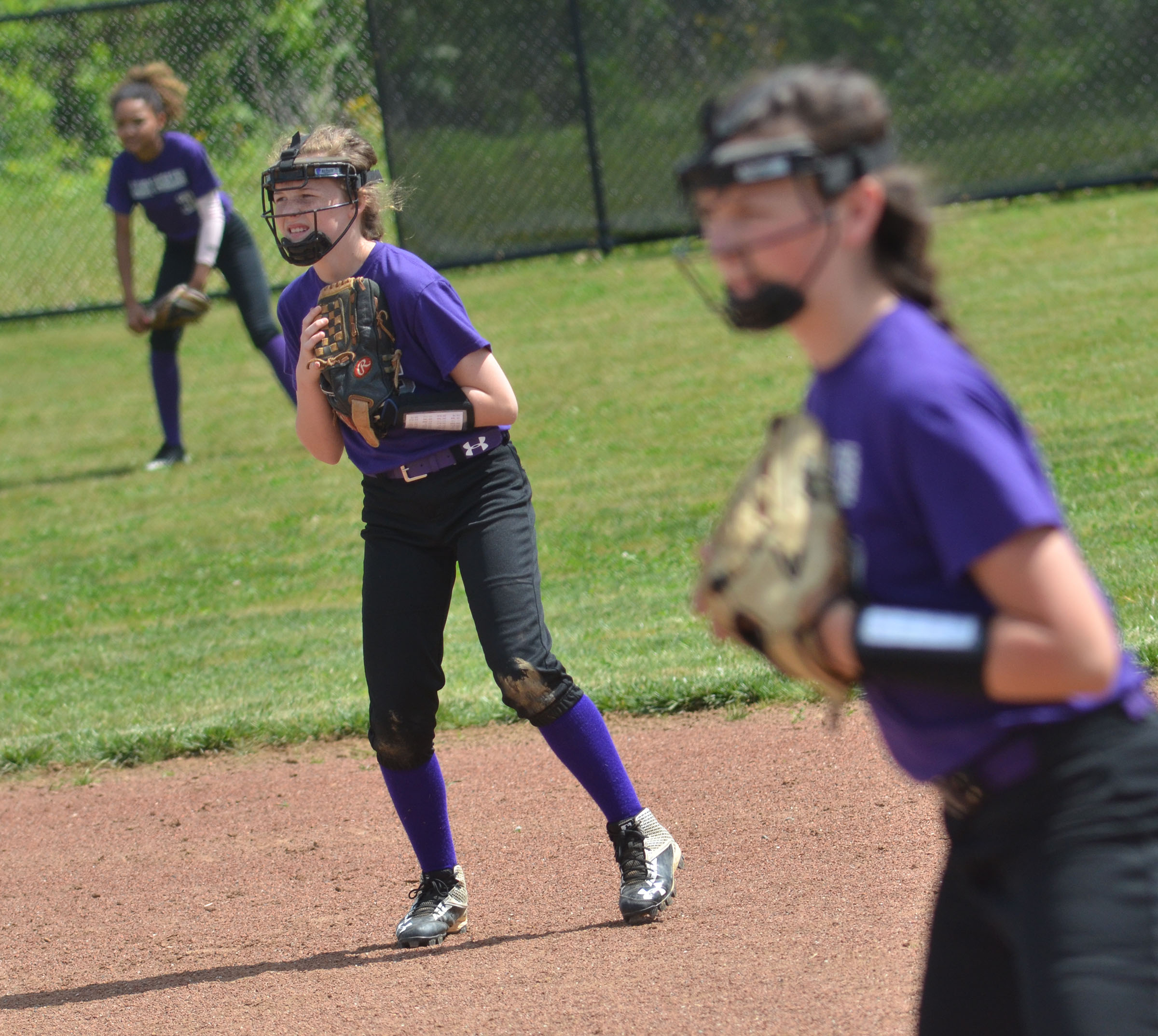 CMS sixth-grader Dakota Slone and her teammates watch the batter.