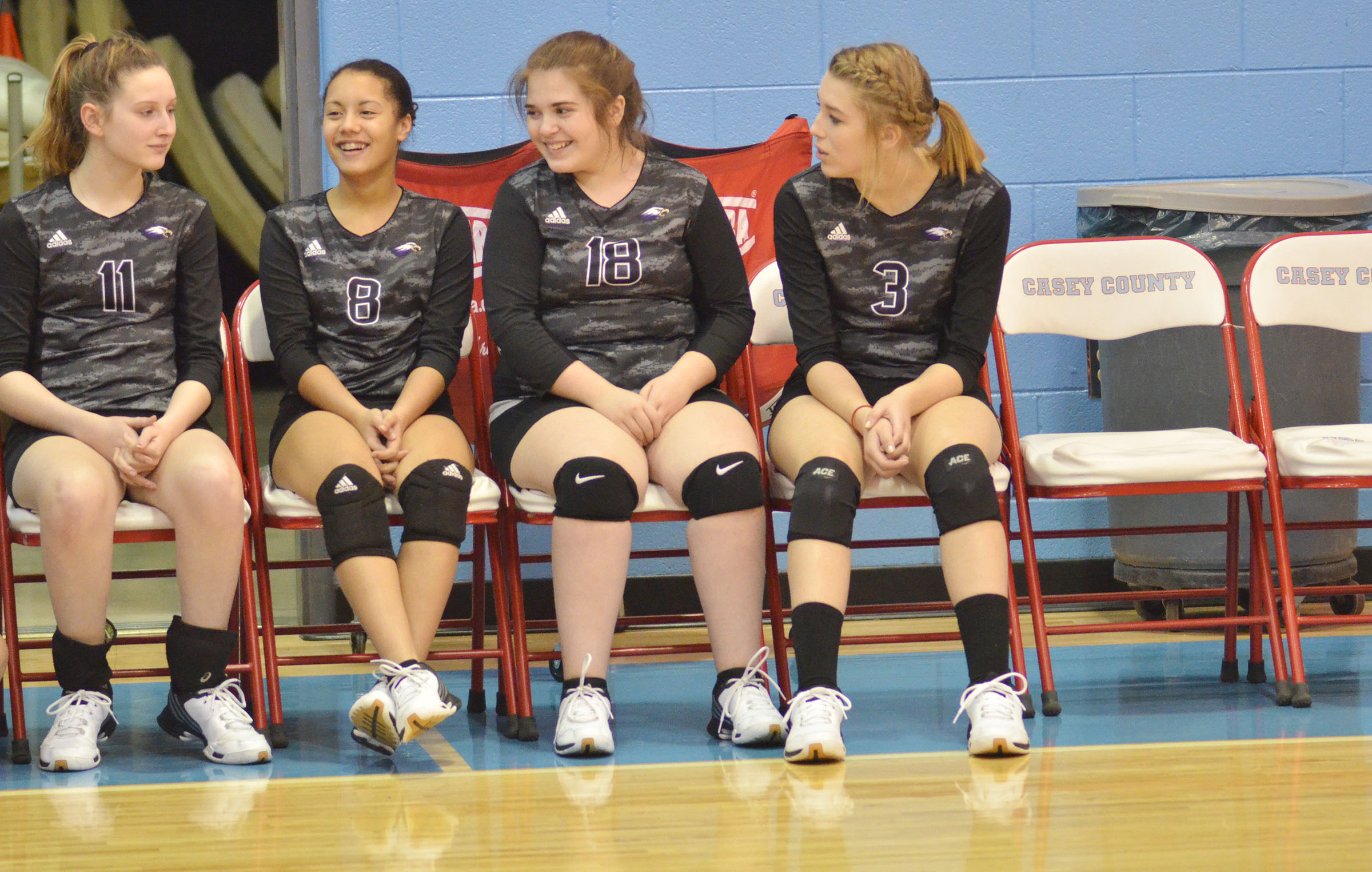 From left, CMS eighth-graders Zoie Sidebottom, Laci Hodgens, Chloe Garrett and Autumn Harvey share a laugh before their match.