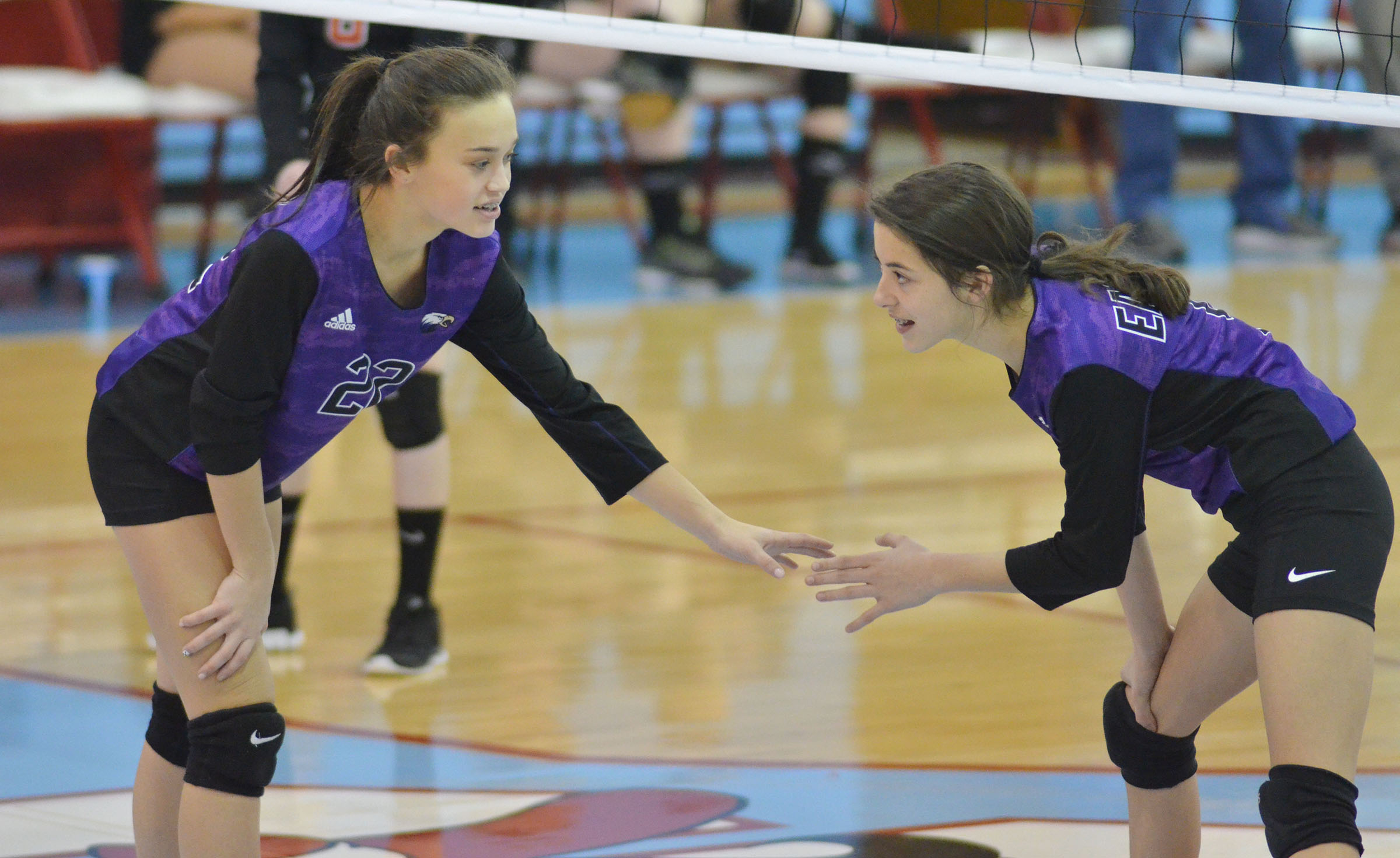 CMS seventh-graders Tayler Thompson, at left, and Kaylyn Smith get set for the serve.