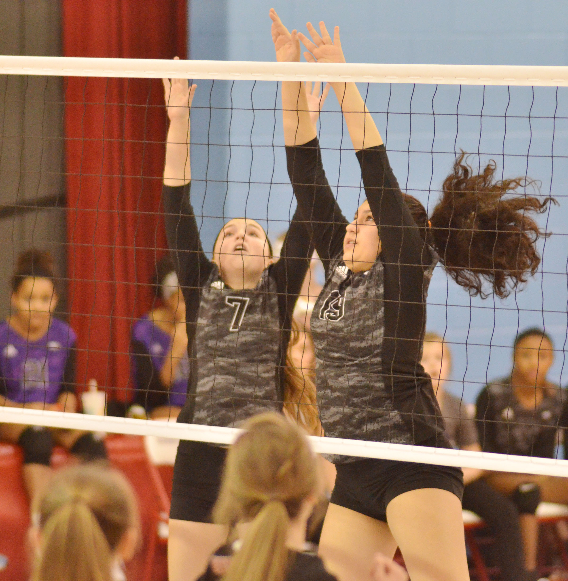 CMS seventh-grader Lainey Watson, at left, and eighth-grader Anna Clara Moura guard the net.