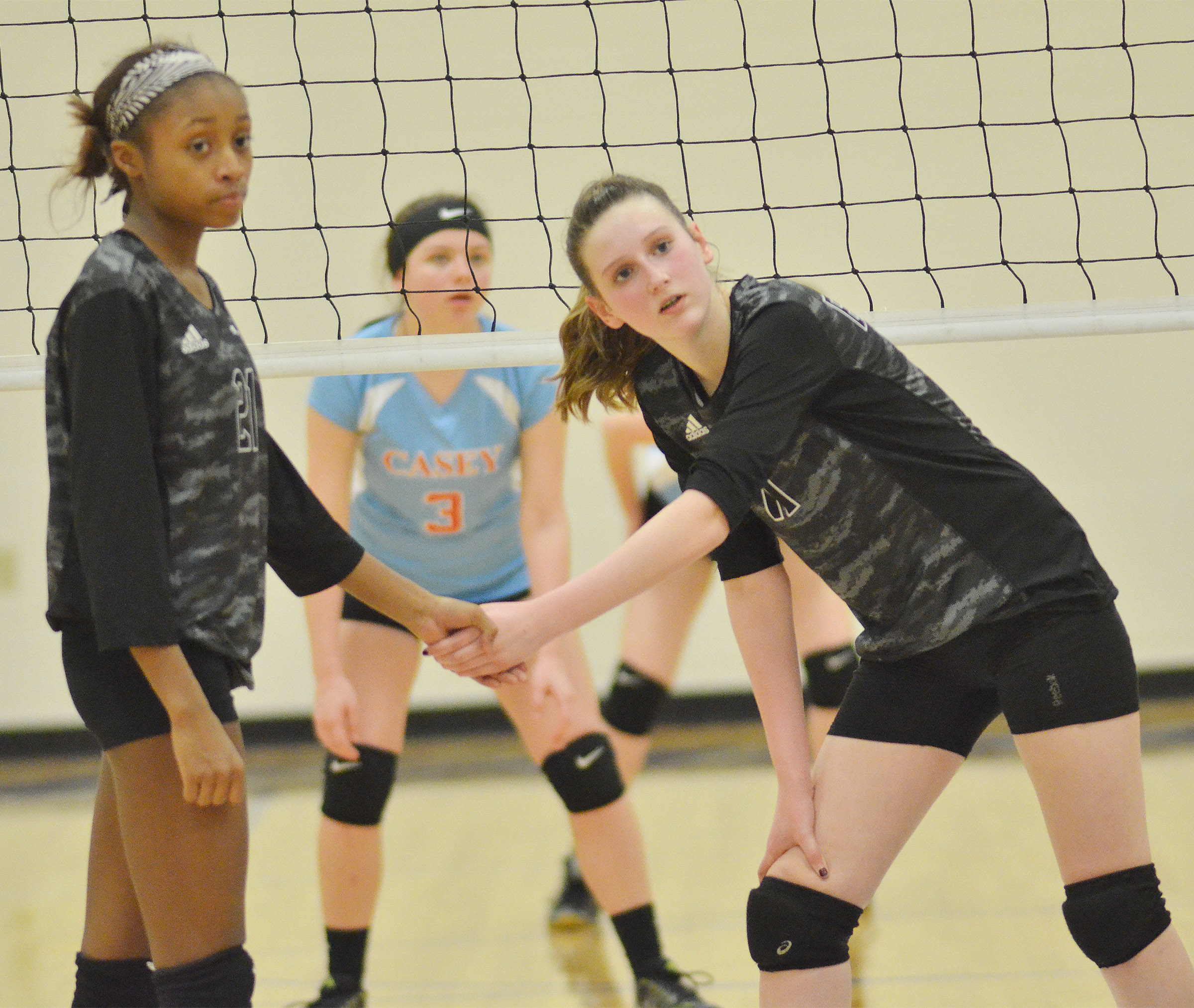 CMS seventh-grader Bri Gowdy, at left, and eighth-grader Zoie Sidebottom get ready for the serve.
