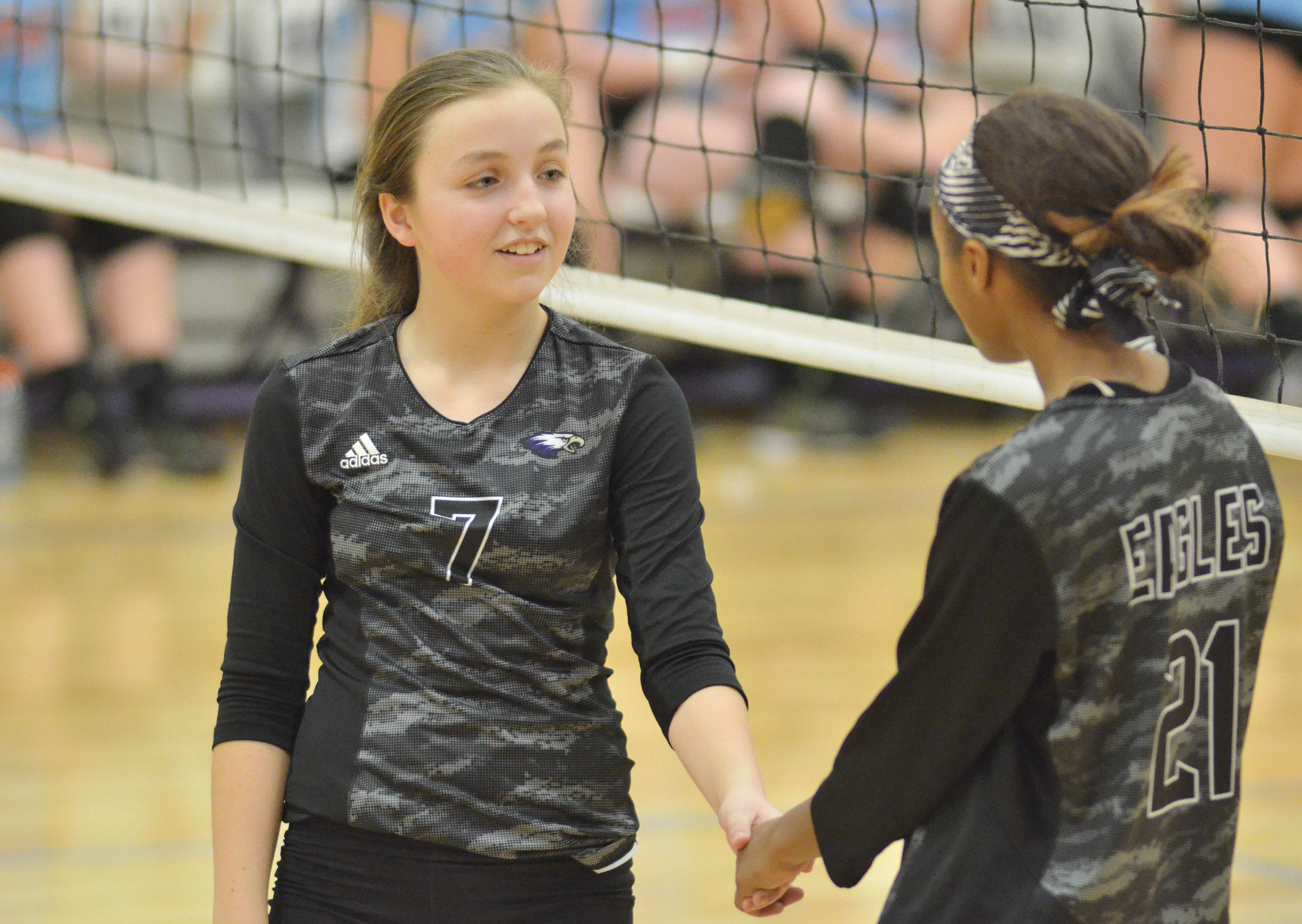 CMS seventh-grader Lainey Watson, at left, and Bri Gowdy get ready for the serve.