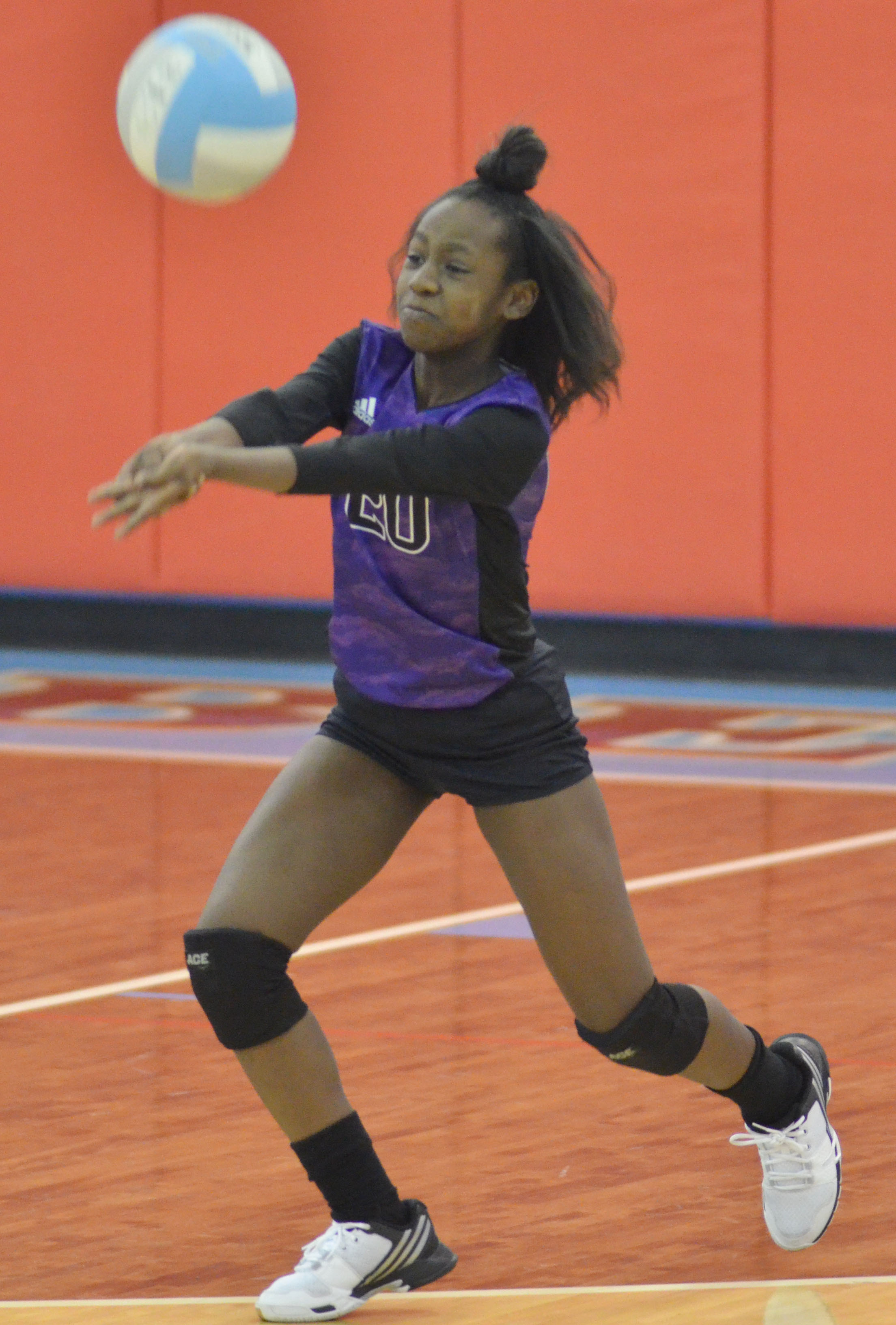CMS seventh-grader Myricle Gholston hits the ball.