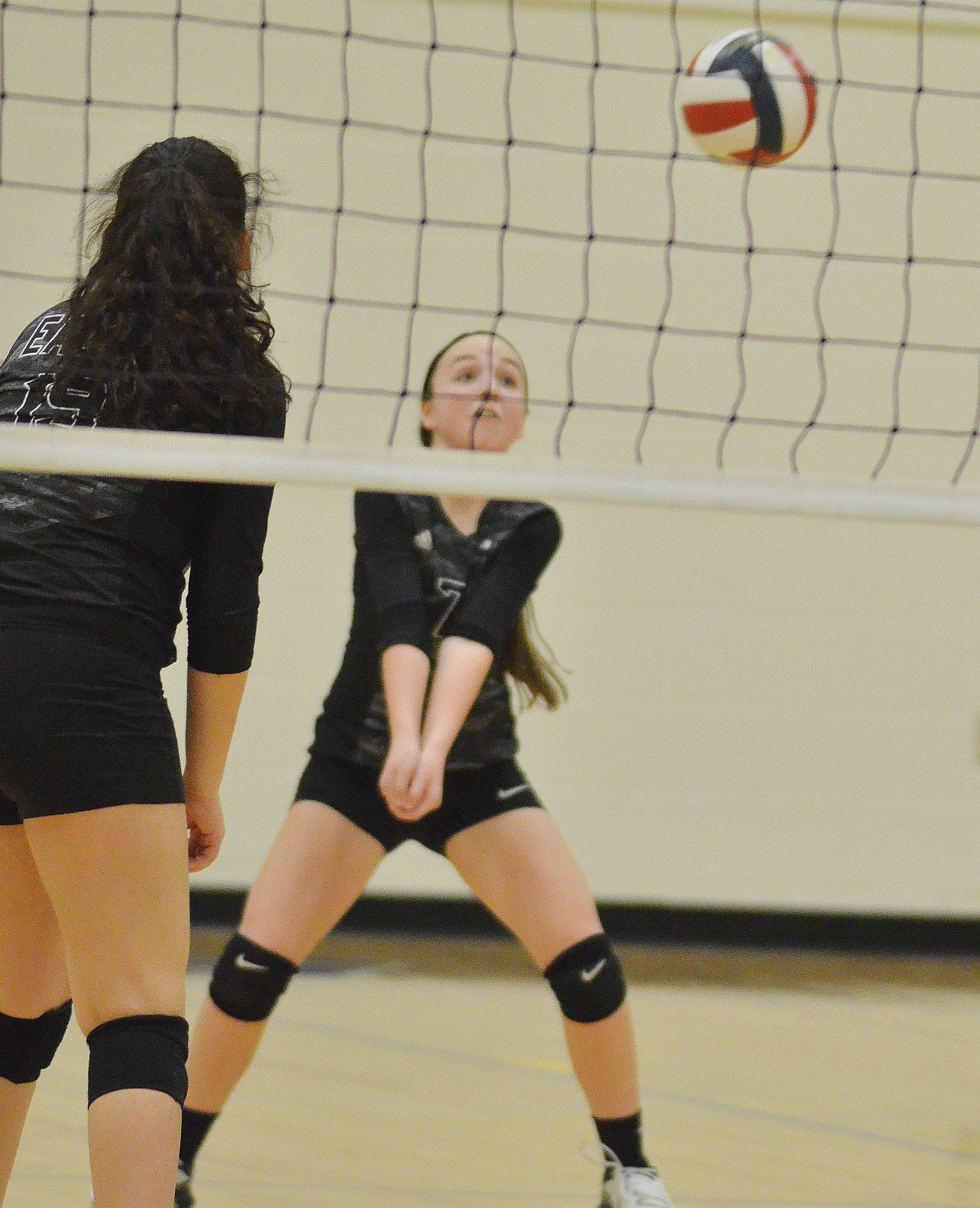 CMS seventh-grader Lainey Watson hits the ball over the net.