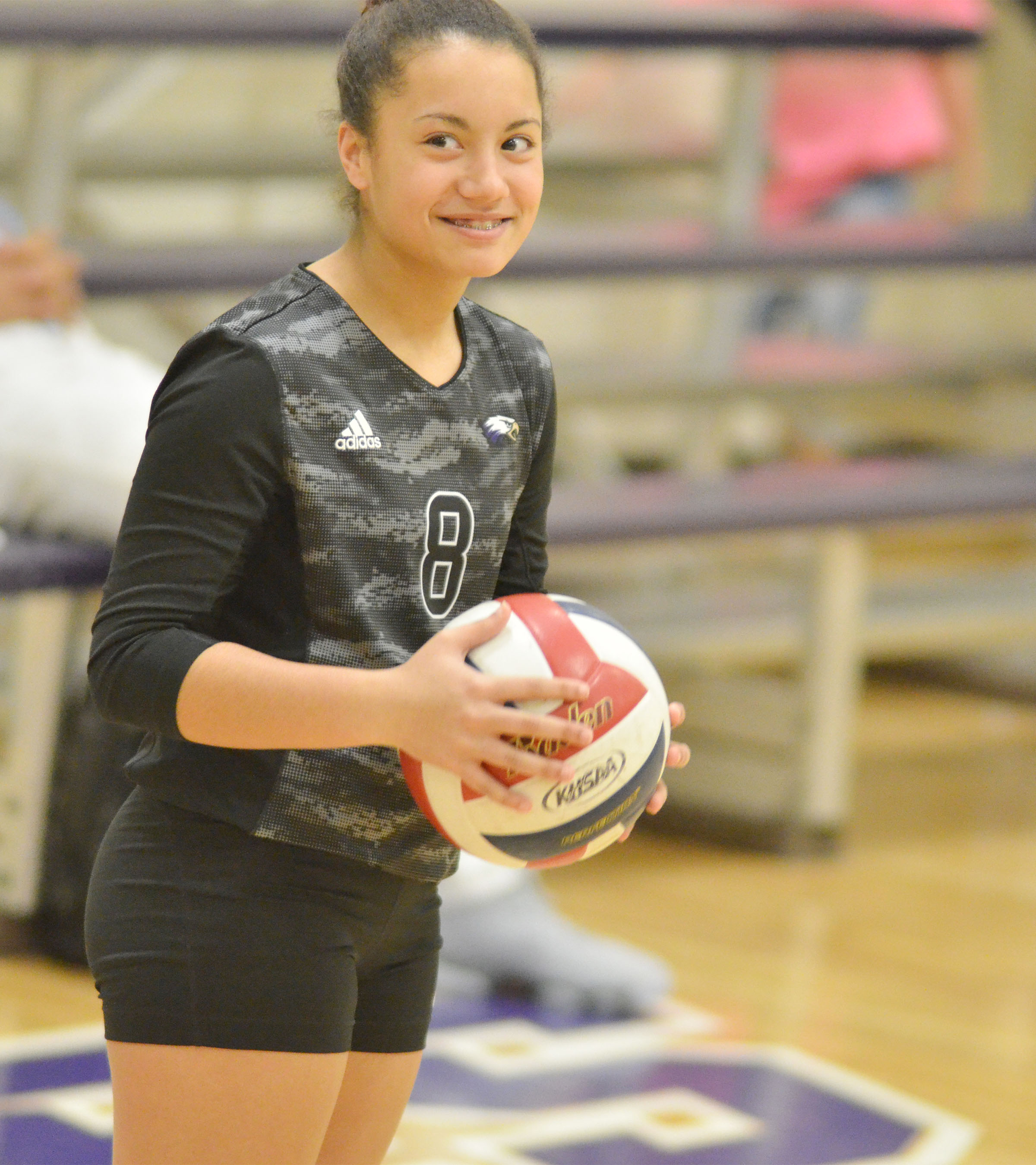 CMS eighth-grader Laci Hodgens smiles before she serves.