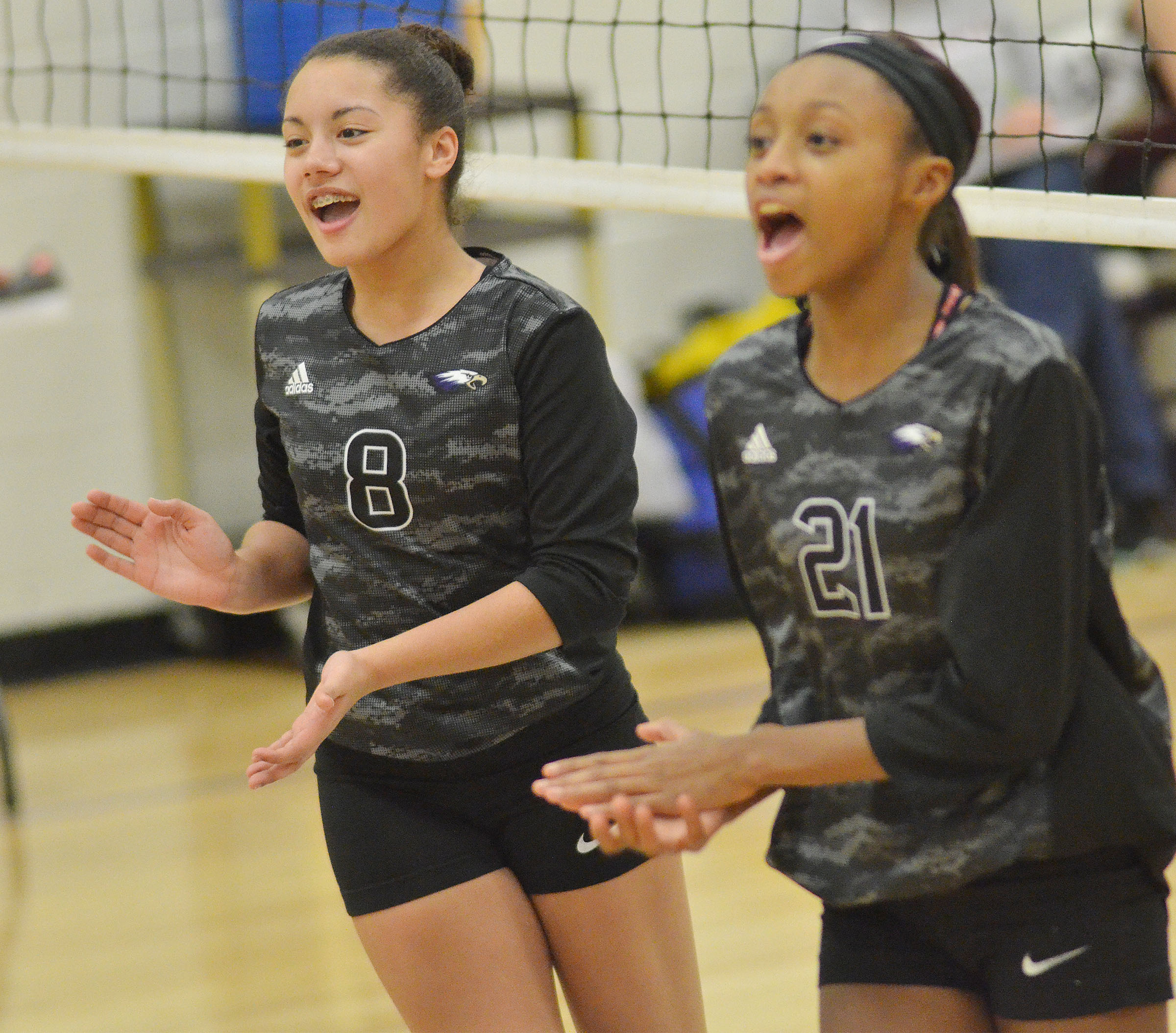 CMS eighth-grader Laci Hodgens, at left, and seventh-grader Bri Gowdy cheer after a point.