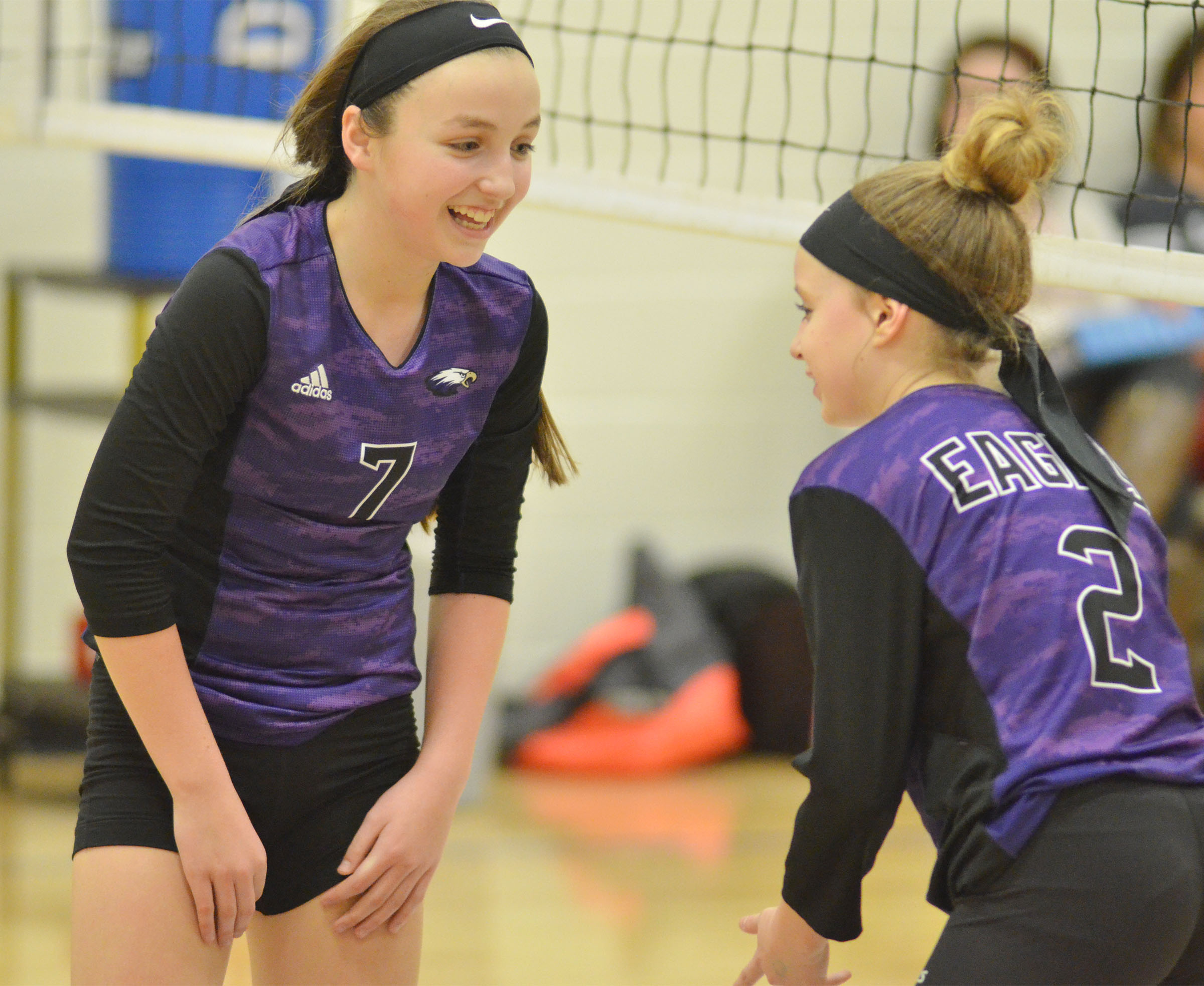CMS seventh-graders Lainey Watson, at left, and Rylee Petett get ready for the serve.