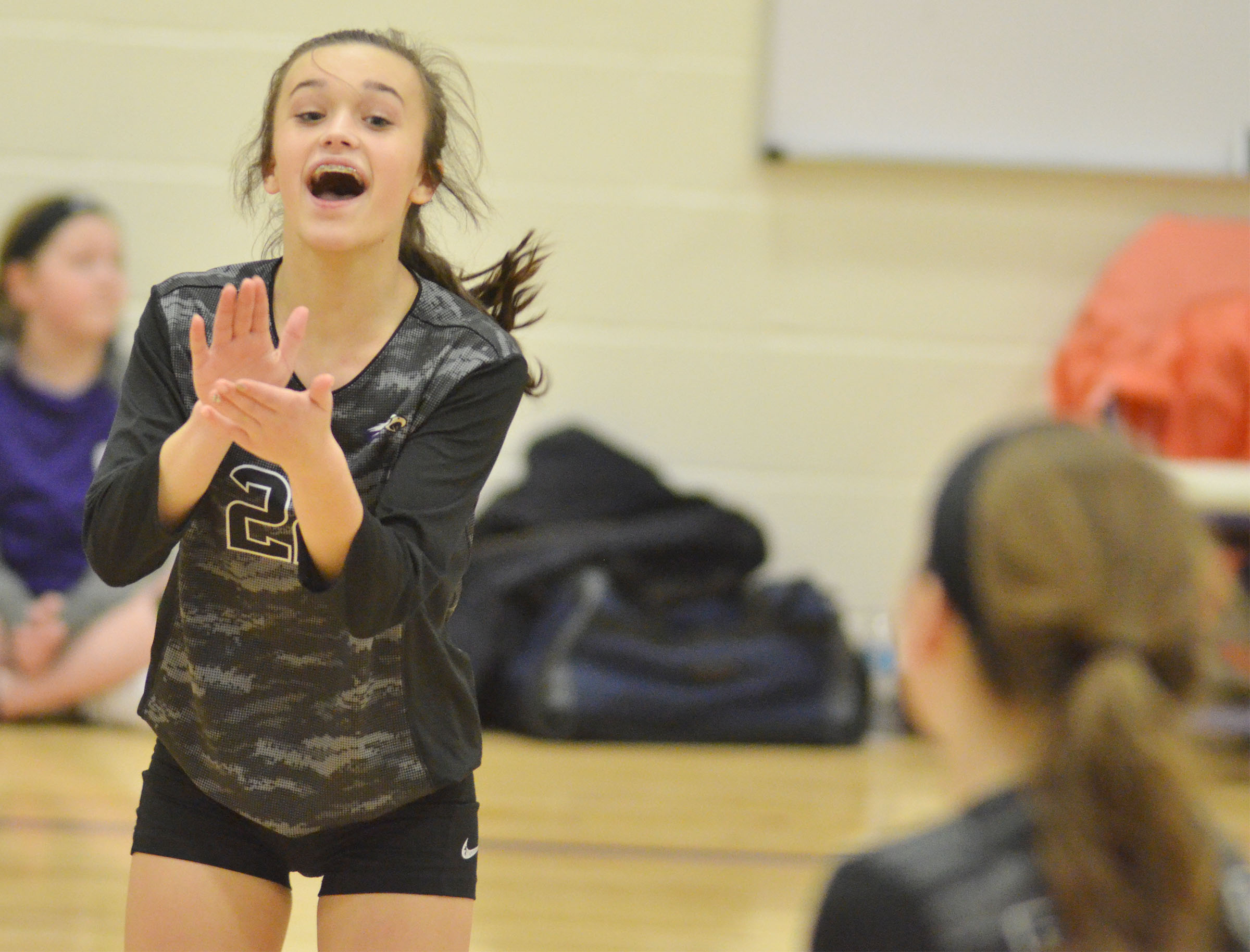 CMS seventh-grader Tayler Thompson cheers as her team wins.