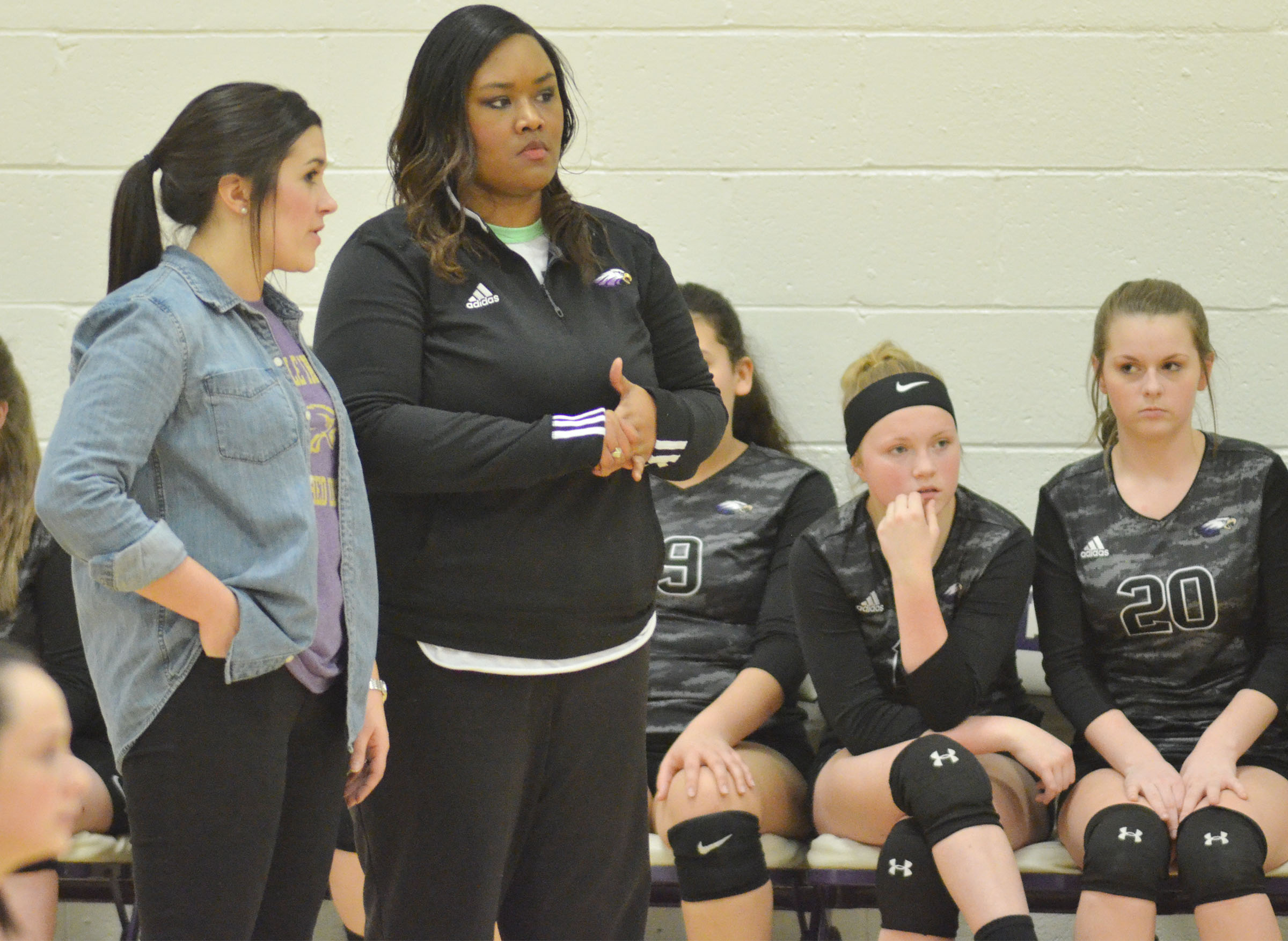 CMS volleyball coaches Hailey Ogle, at left, and Shajuana Ditto talk before the eighth-grade game.