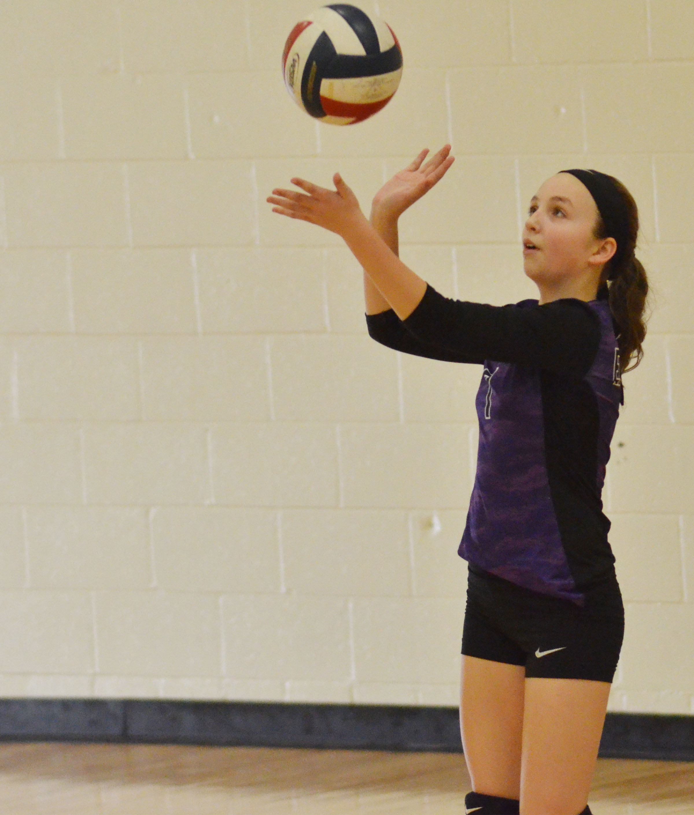 CMS seventh-grader Lainey Watson serves.