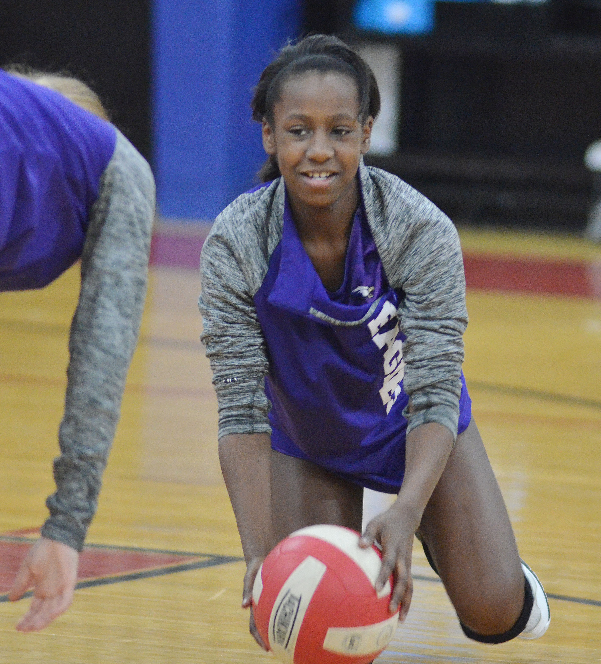 CMS seventh-grader Myricle Gholston warms up before the match.